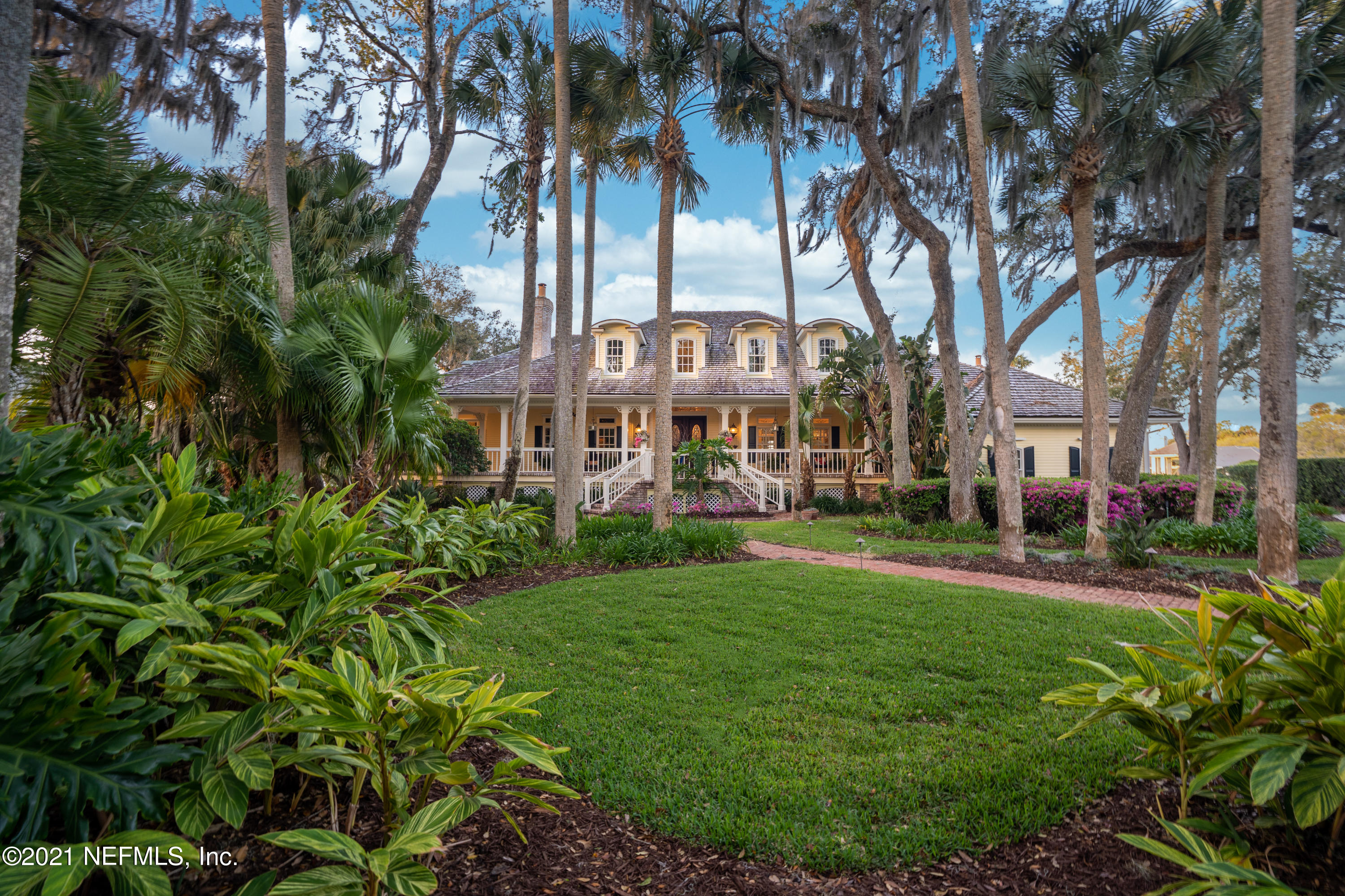 This Southern low-country style beautiful home, featured as one of Ponte Vedra Beach, Florida's most distinctive homes, is in a premier, secure and gated neighborhood within this prestigious beachside community. The property sits on the most premier lot in the neighborhood with a water to golf view overlooking the 36 acre community lake, the clubhouse and the 18th green. This beautiful home has an elegant and timeless design with rich wood floors, custom millwork, and luxuriously appointed interior and exterior finishes.  After walking up the reclaimed brick path and steps, the grand entry with an elegant curved staircase gives way to a spacious living room that seamlessly flows to the charming wrap around porch where you can sit and enjoy the sunset views that are showcased from almost every room of the home.  With over 6300 square feet, 5 Bedrooms, 4.5 bathrooms; 3 car garage,  abundant walk-in closets and storage; home office; home gym; separate family room/ game room, and newly renovated pool with travertine decking, fire pit and summer kitchen, this is the ideal property for entertaining and family living. The main level primary suite offers a private sitting area, double walk in closets and a lavish owners bath with Waterworks fixtures and tub. The chefs kitchen features exceptional brick detailing and is equipped with granite countertops, Sub Zero refrigerator, wine cooler and ice maker, Wolf gas cooktop range, Wolf built-in ovens, Thermador built-in coffee machine , warming drawer, and two Bosch dishwashers.  This property offers a one of kind opportunity to live in a premier neighborhood where it is not just an equity membership, it's a lifestyle.  Within the community is a championship 18-hole golf course, tennis, pickle ball, croquet, fitness center, play grounds and an Olympic-sized pool at the Beach House overlooking the Atlantic Ocean that provides private beach access. Call to schedule your private showing.  Kindly provide at least 24 hour notice.