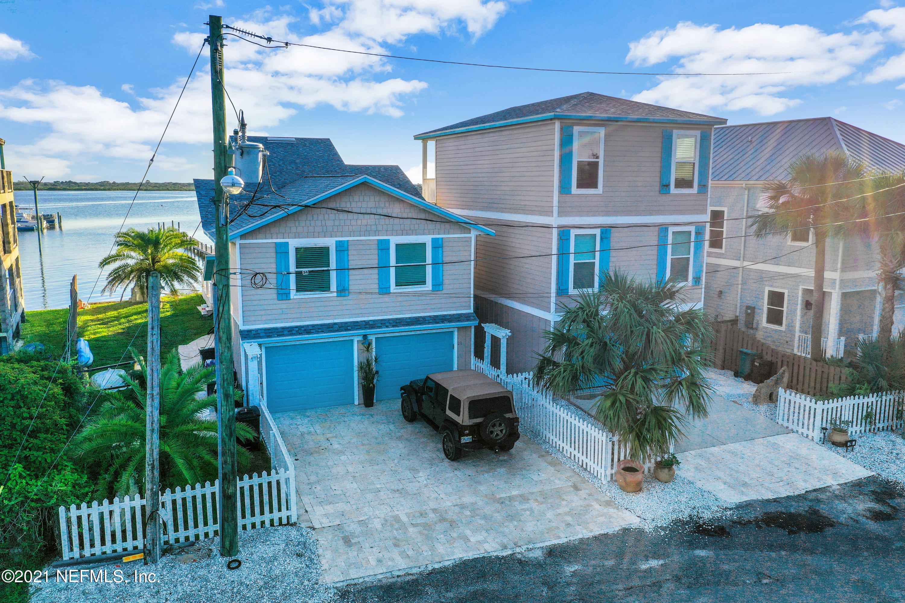 Come and see this breathtaking waterfront home with intracoastal views located on Salt Run! Take your boat out from your private dock in a no wake zone and then come back and soak in your saltwater pool . The dock can support 50'+ sport fisher!!! This property has a total of 4,745 square feet. There is a main house with 2776 sq ft, that includes 5 bedrooms and 3.5 bathrooms and plenty of additional living space. The main house also includes a 2 car garage. It is beautifully remodeled with new bathrooms, new kitchen, new plumbing, and spectacular lighting and travertine flooring. This property also has a detached 3 story home with an additional 2 car garage on the ground level and then the upper two levels of living space. When you step onto the second floor you will find 2 bedrooms and a Jack and Jill bathroom. On the third story there is an open plan kitchen and living room . While on the third floor you must step out onto the deck and you will see stunning views of the ocean , the intracoastal , and the lighthouse. This is a very highly sought after area of town to live in and this home is amazing and unique. This property won't last long!