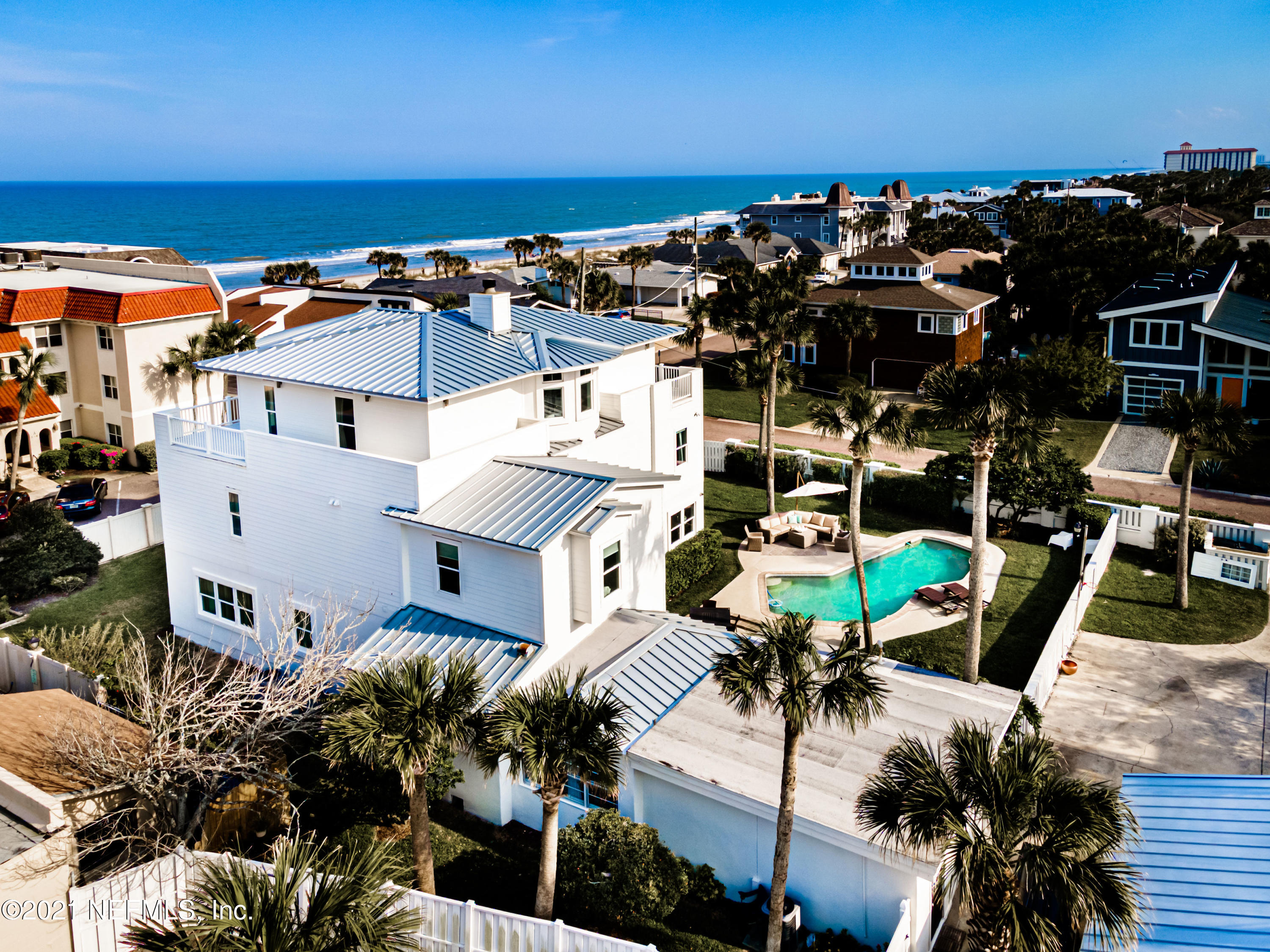 Presenting the epitome of urban coastal charm and elegance: Welcome home to 890 Beach Avenue. Stunning three-story Atlantic Beach pool home across the street from the ocean!  Beautifully updated and thoughtfully renovated to embody the vintage charm and character of Atlantic Beach. Situated on a 150'x100' estate lot with magnificent ocean views, detached garage and separate guest home. Walk through the double door entrance into a grand foyer with two-story cathedral ceiling, leading to a captivating curved staircase designed to exude the ultimate architectural ambiance. Open floorplan with gas fireplace and custom kitchen built for luxury and entertaining with attention to detail and options including JENN-AIR built-in appliances, quartz counters, custom cabinetry with soft-close hardware decorative frosted doors, kitchen window sink, trash compactor, organization enthusiasts' dream walk-in pantry housing automatic lighting, custom built-in shelving and drawers, large separate entertainment prep island with quartz counter, bar sink, ice maker and wine cooler. Powder room with opulent custom tile. Expansive laundry room is easily able to house crafting/creative project area with built-in drop zone wall keeping clutter contained and hidden. Closet areas throughout offer extra storage, including hallway tech closet for convenient central location of wired whole-home sound system, alarm, security camera, and tech equipment needs. The 2nd floor offers four bedrooms and two bathrooms, including a complete guest suite with private bathroom. The 3rd level houses the luxury owners retreat. Large landing leads to lounge and exercise area with separate office. Owners' bedroom faces ocean with window views plus private ocean-facing balcony. Feature-rich owners' bath including marble counters, seamless shower, separate bathing room which highlights freestanding soaking tub, two separate owner closets with one leading into an additional private dressing room. Exterior features include detached two-car garage and separate guest home. Guest home includes family room, full kitchen, bedroom and bathroom. Native plants offer low-maintenance landscaping. Non-conforming privacy fence allowed due to being built prior to current AB fencing regulations. The side/front yard features a small herb garden with raised beds, including play yard with rubber mulch, outdoor pool with entertainment patio surround making a convenient stop after an ocean swim. Nestled in Atlantic Beach, steps away to the ocean. Bike or walk to nearby parks, restaurants and shops while reveling in the best of beach life. Public beach access on 7th.