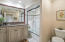 Services Bedrooms 2 & 3 Tub w/ vanishing glass doors raised vanity
