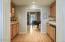 Cabinets are plentiful, Bar Sink, Beverage Fridge, Tile counters & backsplash