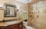 This bath services bedroom #4. Shower Stall w/vanishing glass wall & door