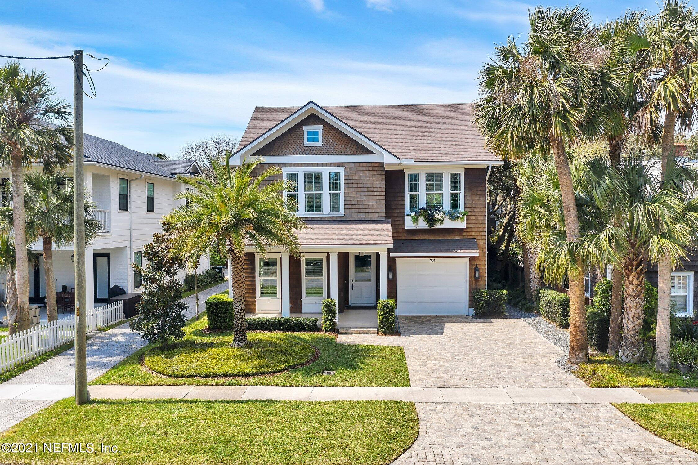 Welcome to this recently built custom cottage-style home in the heart of old Atlantic Beach. One of the most coveted locations within a vibrant community, this home is just one short block from the beach and three short blocks to the Beaches Town Center. For those looking for a walkable neighborhood, the next owners of this home can walk to local open-air coffee shops, cafes, and bars all year long. The open floor plan features a spacious kitchen and great room that is perfect for hosting friends and family. Interior features include 10' ceilings on the first floor, custom stair railing, inset fully custom all-wood Shiloh cabinets, high-end Wolf/Sub Zero appliances including a 146-bottle built-in wine refrigerator with dual climate zones, oversized quartz waterfall island, butler's pantry, separate dining room, beautiful wood floors throughout, custom built in closets, built-in ceiling speakers, epoxy garage flooring, shiplap ceiling and wall accents and much more! Step into the backyard and feel like you are in your own private resort underneath the spacious, covered patio with a lovely built-in summer kitchen surrounded by resort-like landscaping and palm trees. Additional outdoor features include an outdoor shower, tiled front porch, mature tree canopy, wood cedar shake siding, window planter boxes, and elegant landscape lighting. 350 Ocean Blvd has it all. Come see this beautiful house for yourself and fall in love with your new home!