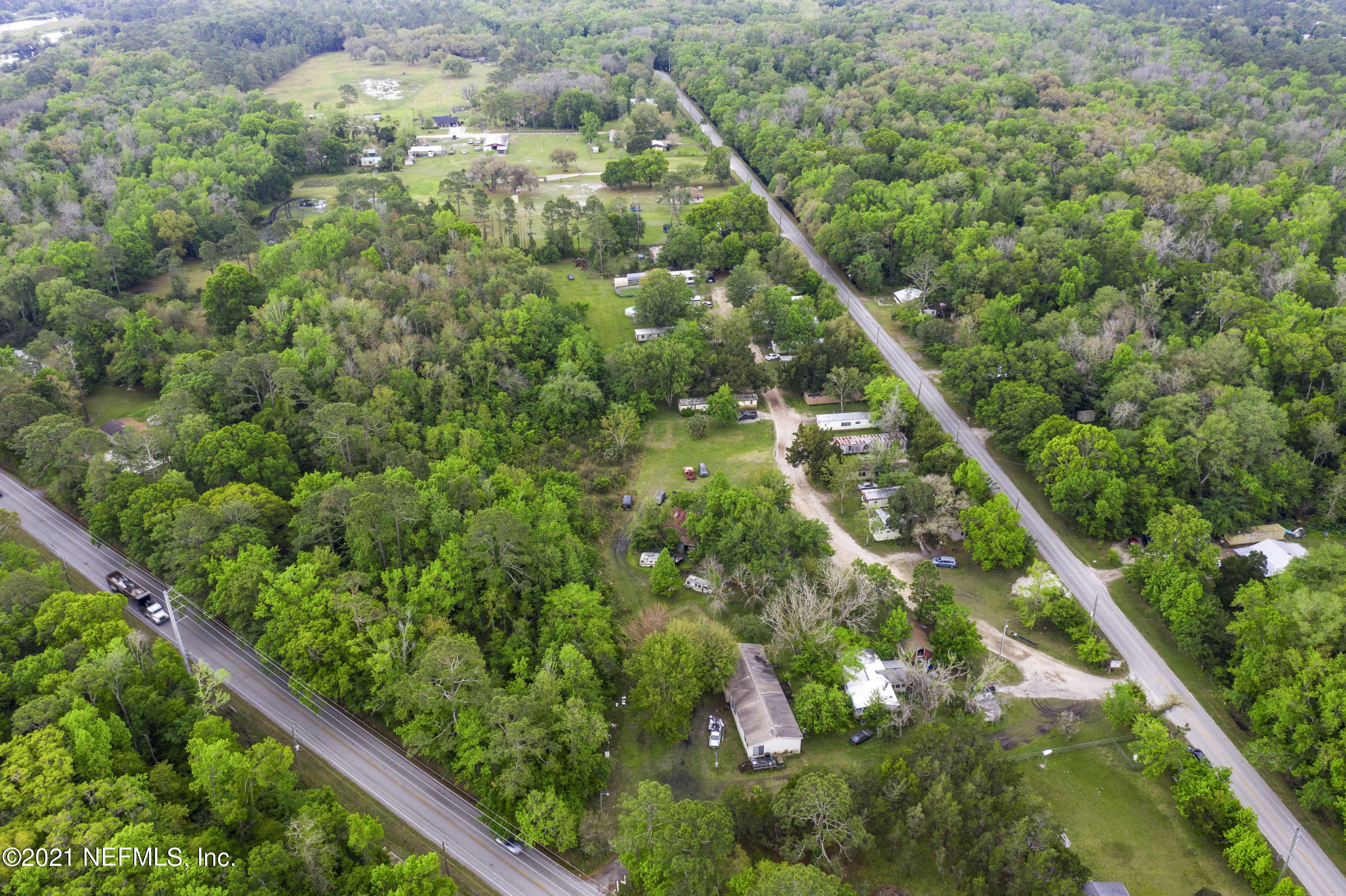 Property is in Opportunity Zone. 6.54 Acre parcel with two mobile home units and a barn located on the parcel. Mobile #1 is a 2007 Fleetwood Doublewide 4/2 (30x80) at 100k value. Mobile #2 is a 1980 Smaller 4/2 Doublewide(28x55) needs 25k work. Barn is 30x20. Well and septic on the property. Could be good for a neighborhood development with access to Four Mile and Deer Run. Presented Separately or in conjunction with 2510 Deer Run Rd, a 4 acre 23 unit mobile home park.Inquire for more information.