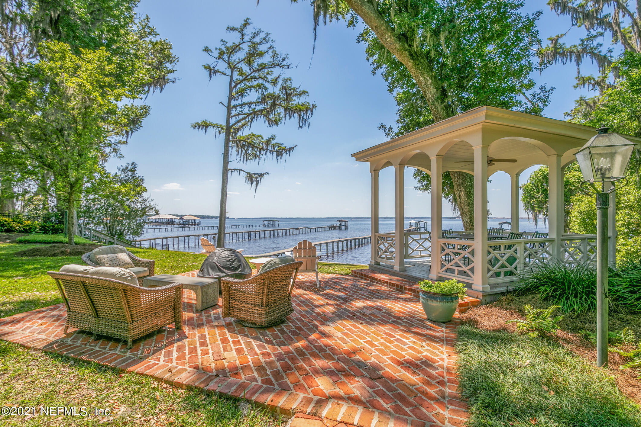 Charming and wonderful doesn't begin to describe this lovely San Jose Riverfront. From the moment you drive in the circular drive and walk through the front door you will want to call it your home. Designer finishes found throughout every room. Kitchen and Master Bath along with new additions to the home were done in 2006. The lifestyle and comfort derived from riverfront living is the ultimate. Spacious living areas that flow from room to room make entertaining easy and enjoyable for all. For cooler evenings you will love the fireplaces found in the breakfast and formal living rooms. 2nd Story guest suite offers private entrance, bath & balcony. If not needed for bedroom a perfect place for home theatre or bonus room. Hop in your boat easily for leisure ride or head to the Atlantic Ocean