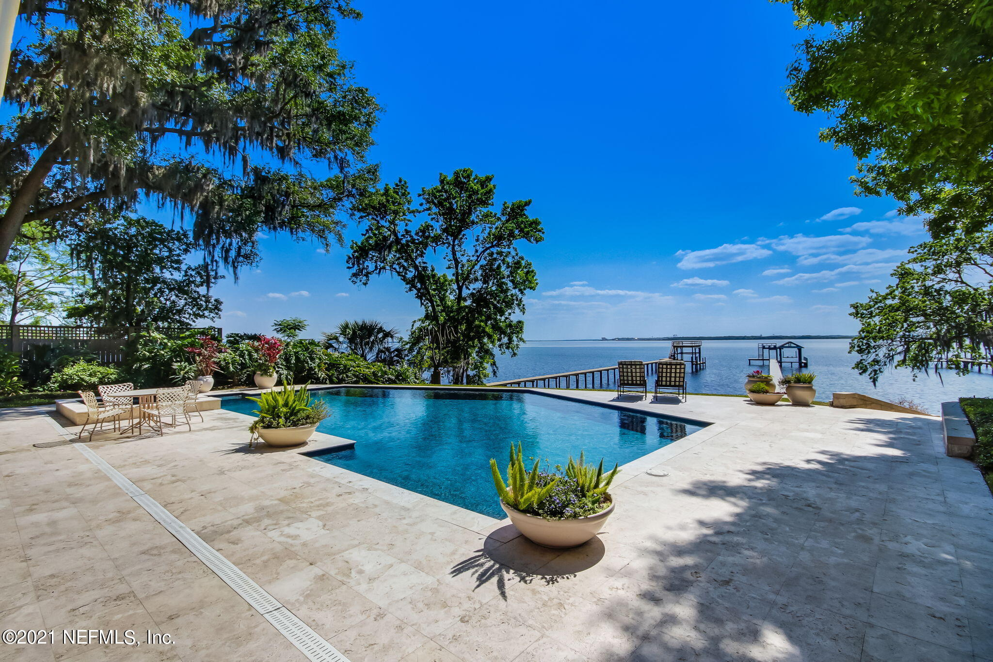 Stunning waterfront property located in the heart of Jacksonville, just minutes from the San Marco Square. Surrounded by lush landscaping and majestic mossy oaks, this contemporary cedar shake home is sure to wow the most discerning tastes. Over 4500 sq ft of thoughtfully curated space. Breathtaking views of the St. Johns River from every room! Chef's kitchen boasts Subzero and Thermador appliances as well as a beautiful, spacious island. Dine alfresco with a glass from your wine cellar, next to the sparkling pool. Built in entertainment for the whole family, including playground, ping pong. Then, hop on your 30' boat from your dock. Energy efficiency made possible by solar panels, foam insulation and 16 kv Generac generator. Luxurious North Florida living at its finest!