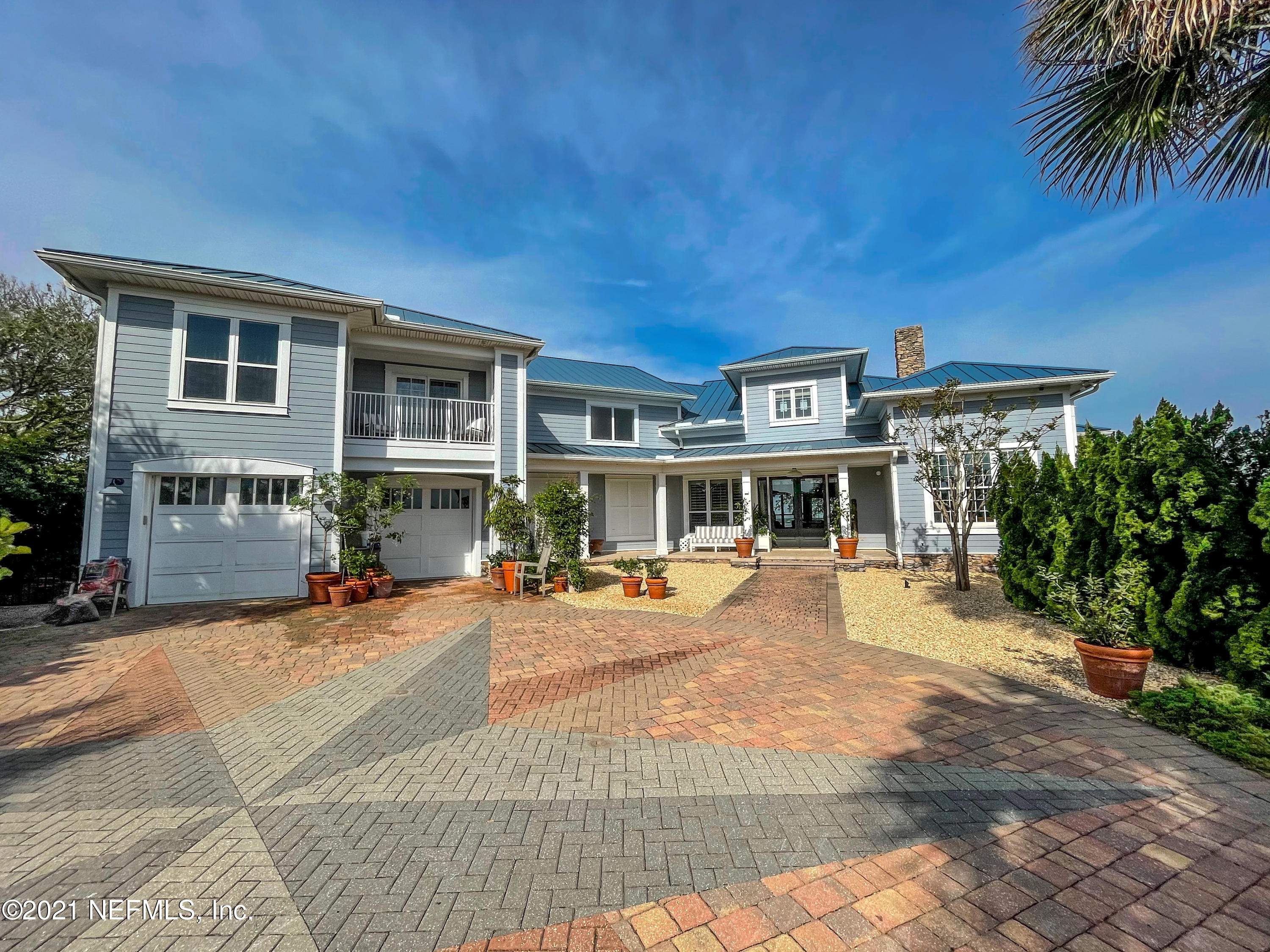 This COMPLETELY RENOVATED, peaceful oasis sits on 1.73 acres directly on the Intracoastal Waterway.  The architectural details of the Andrew Howard designed modern coastal interior are stunning. This home has been featured in Coastal Living Magazine & was featured on the  cover of Kiplinger Magazine in 2019. From the newly renovated master suite to the terra cotta backsplash to the custom kitchen hardware, this home has it all. The kitchen is magnificent and features custom cabinetry and a walk in pantry. There's  2 master suites one upstairs & one down positioned to leverage the incredible water views and the master baths are spectacular!  Set sail from your very own dock & be in the open ocean waters in minutes or take a quick walk & enjoy your day on the beach. Come live the SALT LIFE!