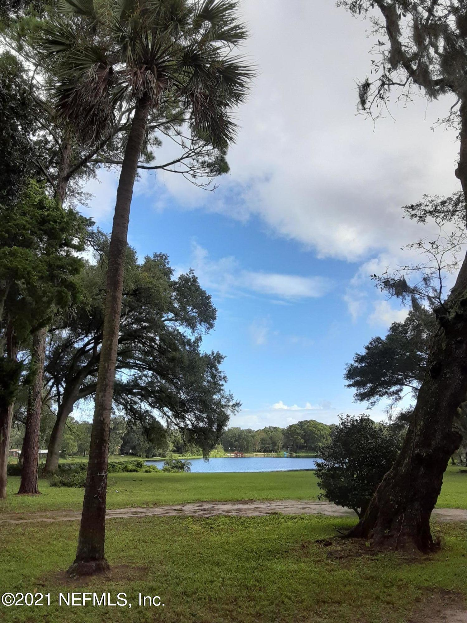 Great Investment Opportunity to own .This Property consist of 5 single family houses that are currently leased. Nearly 3 acres . Peaceful lake view. Please do not disturb tenants