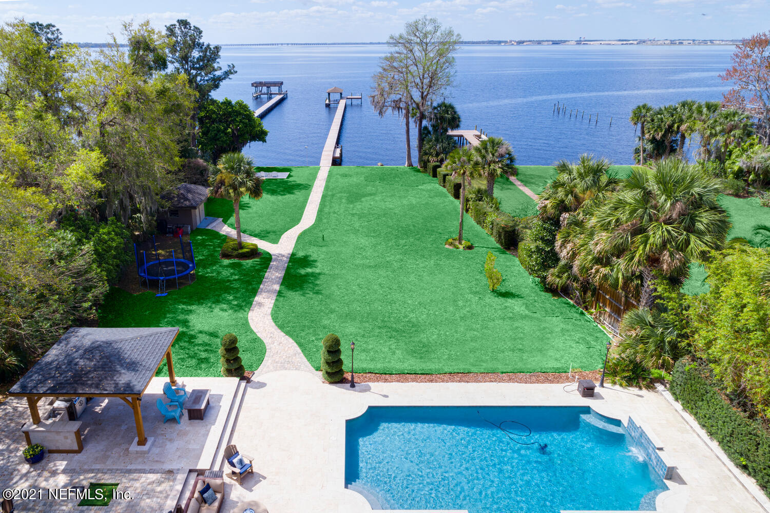 AMAZING RIVER VIEWS & SUNSETS!! Stunning and spacious home perfectly nestled on a deep St. Johns River lot just one block north of The Bolles school! Complete with newly renovated kitchen, master suite and bathroom with steam shower. BRAND NEW ROOF, newly rebuilt dock complete with boat lift. New luxurious state-of-the-art, heated pool w/ LED lighting with patio & summer kitchen - everything you need to entertain or spend your afternoon watching the beautiful sunset in the comfort of your own waterfront sanctuary! Updates galore, including kitchen, flooring, electrical, plumbing, windows, HVACs and much more! Please see attached list of improvements. Unique opportunity to own a private riverfront estate with a deep lot; must see to appreciate!