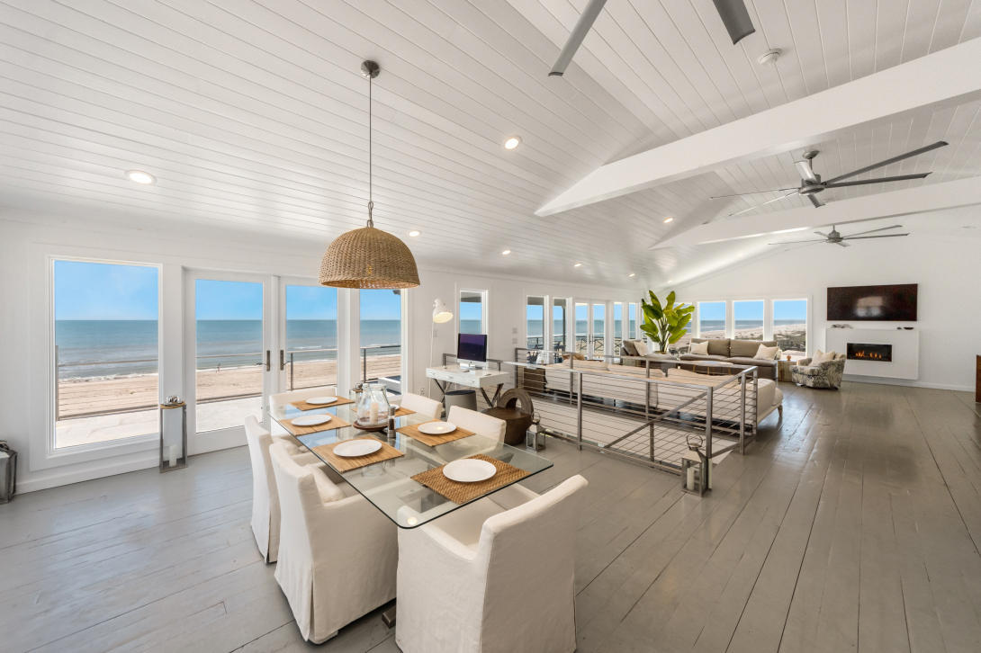 A rare highly-coveted turn-key stunner on Main Beach with the most incredible panoramic views on the island, 100' of direct beachfront. This California-inspired designer home has breathtaking views of the ocean from all but one room, boasts private direct access to the gorgeous beach. Elevator, chef's gourmet kitchen with Thermador appliances +2 wine fridges, expansive open-concept living, dining, and entertaining areas, generous loggias with endless ocean views. Separate MIL suite with ocean views and access to the adjoining grand patio and spa. Outstanding design, construction quality and aesthetic one expects from such an opulent oceanfront setting. 5min walk to Egans Creek trails, 1-mile walk to beach restaurants in both directions, 8min drive to historic downtown restaurants/shopping.