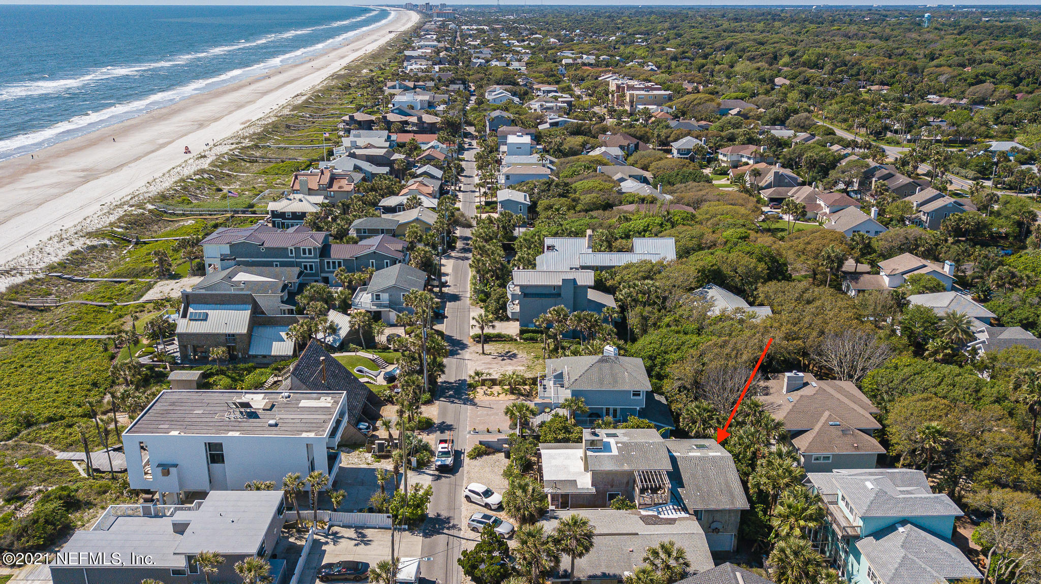 This amazing ocean view property sits near the highest point in Atlantic Beach. Walk steps out your door to the 19th St. beach access. Enjoy coffee and ocean sunrises from the balcony on the front of the house. It's a short bike ride to Beaches Town Center or Atlantic Beach Country Club.Property consists of two 3 bedroom, 2 bath homes, one 1 bedroom apartment, and an efficiency apartment. The largest unit has a two car garage. The other 3/2 has a 1 car garage. Live in one unit and keep the other 3 as rentals or build your dream home on this 100X100 lot with ocean views! All 4 units currently rented with leases that expire in June 2022. There is a 60 day notice for tenants to exit.  See documents for list of appliances and appraisal.