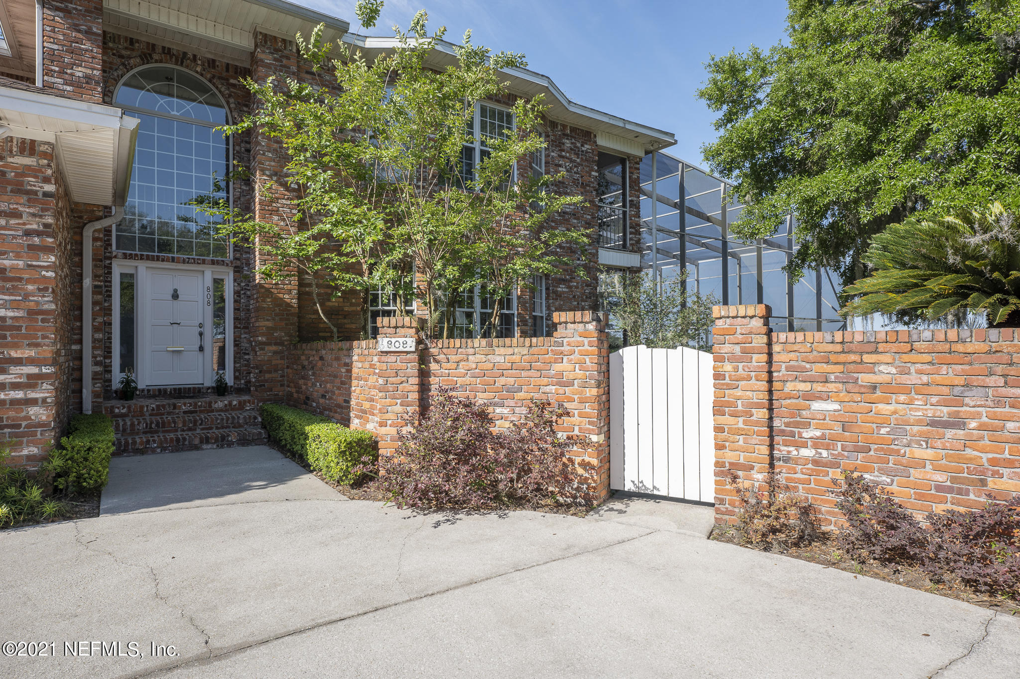 This 1990 brick-built riverfront 4 bed, 5 bath 5300+ SF home comes with its own dock, boatlift, and boathouse on .49 acres in prestigious South San Marco. This home was Custom built but fits into 2021's modern floorplan. Open flow and great for entertaining. Every bedroom in this executive home has an en-suite bathroom. Open all the doors to enjoy the view from the living area across the pool to the St. Johns River, even when sitting in your indoor hot tub near the exit to the enclosed pool deck, MUST SEE to believe. Sit at your boathouse and watch the sun set. Owner's Suite comes equipped with a wet bar and fireplace. The guest and owner's suite share a balcony overlooking the pool and the multi-million-dollar view of the river. Everything about the house is set up for entertaining. The yard can easily host birthday parties, weddings, graduations or anything you want to celebrate. On one side of the home you can enjoy a private garden area and on the other a large private locked shed. Remember to check out the oversized three car garage. Roof was replaced in 2013 and the home already has newer AC units. This home has Immaculately cared for, you can do some cosmetic changes to the home and make it a family treasure for decades.