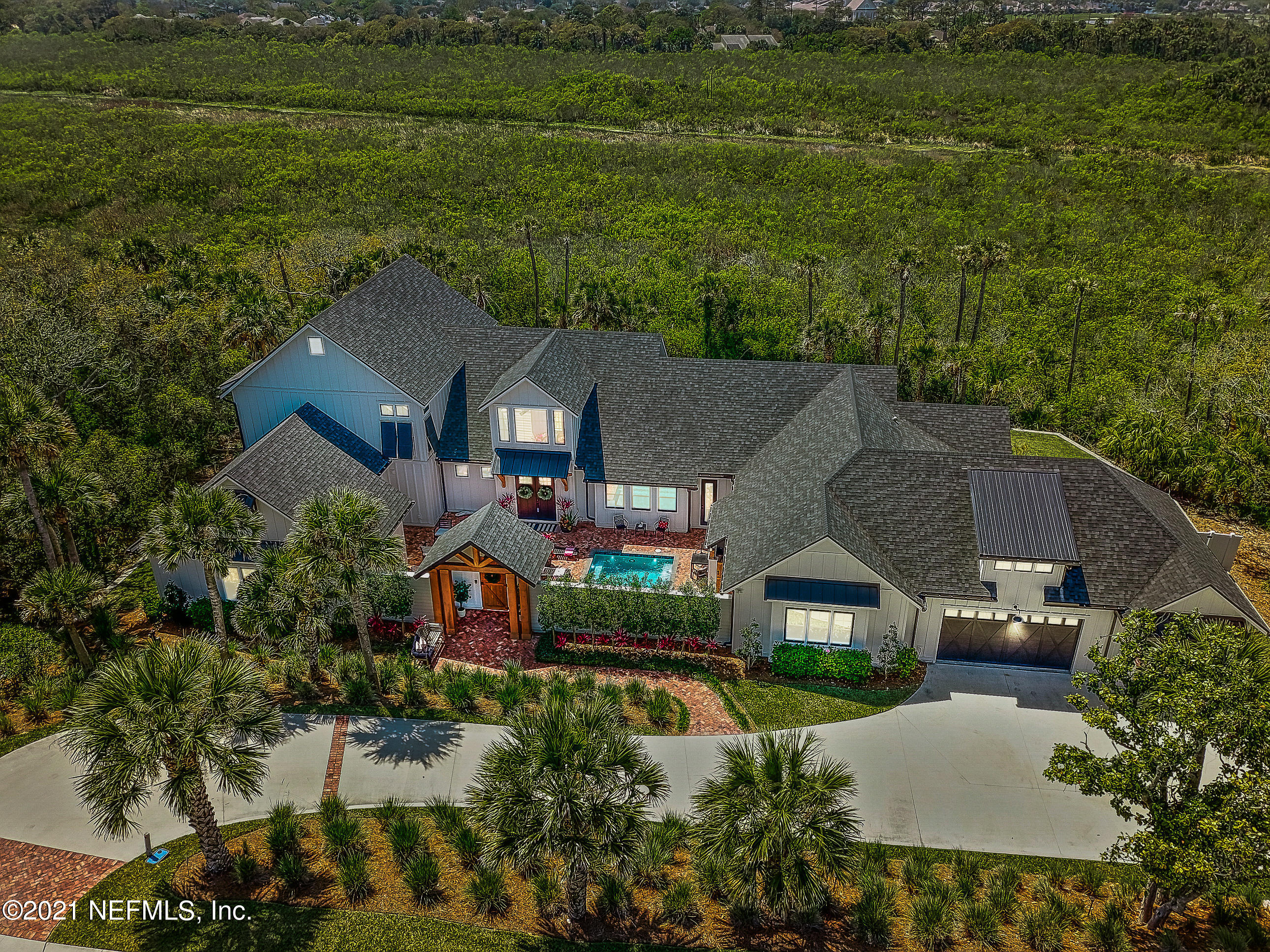 "Spectacular One of a Kind Home on Prestigious Ponte Vedra Blvd w/ Private Deeded Beach Access Has Too Many Features to list here see Attached Sheet with Specs. 200 ft Private Lot surrounded by Nature, Farmhouse Meets Beach House. Hickory Wood Floors, Stunning Gourmet Kitchen 9 ft Island, Shiplap, Oversized Black Light fixtures, Expansive Old Columbia Brick outdoor patios & entertaining space, Spa Owner's Bath Retreat, 3 Fireplaces, Courtyard Pool, Huge Column Fridge & Freezer, Lounge/Sitting Area, Casita w/En Suite Bath, Climate Controlled Summer Kitchen & Living Room w/Glass Rolling Door for indoor/outdoor living, Custom Solid Wood Cabinets in Kitchen, All Baths, Laundry, Mudroom w Custom Storage Bins, Bench, Heated Pool, *Listing Agent Holds an Interest in Property **24Hrs Notice to Show NOTABLE FEATURES The Crowning Jewel of this Spectacular Home is 15 Steps to Your Very Own Beach Access Where You will Enjoy Privacy & Seclusion with Breathtaking Sunrises and Glowing Sunset Skies!  Private/ Exclusive Single Owner Deeded Beach Access for this Parcel Only and Transfers with Property To All Future Owners  200 Ft Double Lot on Prestigious Ponte Vedra Blvd, this Private Homesite Backs Up to the Guana Nature Preserve, Protected Privacy Forever and Surrounded By Nature!  And, You Will Enjoy Stunning Unobstructed Sunset Views Every Day! An Unexpected Bonus is Your Very Own Firework Show Compliments of Sawgrass Every 4th of July the Fireworks Light Up the Sky Over Your Backyard and the Guana Preserve!  Highly Functional Floor Plan- Lives like a Single-story Home with Ground Floor 3-way Split Bedrooms for Privacy, with 2 Additional En Suite Bedrooms on the Second Floor and Separate Casita with Huge Bedroom and En Suite Bath  Custom Distressed Hickory Wood Flooring Throughout All Living Spaces  Spectacular Gourmet Kitchen Featuring a Huge Custom Solid Wood 9+ foot Island with Quartz surface, Wolf Appliances: 48 inch 8 Burner Natural Gas Range and Two Ovens, Wolf Microwave/Convection Oven, Wolf Warming Drawer, Huge Double Column Stainless Steel Refrigerator / Freezer, Farmhouse Sink, Pot Filler, Custom Solid Wood Cabinets with Quartz Counter Tops, Utensil & Spice Organizers, Slide-out Shelves All Base Door Cabinets, Soft Close Doors & Drawers, this Kitchen has Enormous Storage Capacity with Floor to Ceiling Cabinets with Crown Moulding and a Total of 86 Doors and Drawers! Stunning Oversized Stainless Steel Hood flanked by Custom Cedar Floating Shelves, Very Large Pantry with floor to ceiling built-in Shelving for tons of food and appliance storage  Custom Coffee / Espresso Room with Sink, Custom Solid Wood Cabinets, Quarts Surface & Cedar Floating Shelves  Spa Retreat in Owner's En Suite Bath Featuring 12.7 ft x 8.5 ft Shower Area (yes you read that correctly, it's Gigantic!) with Gorgeous Soaking Tub Overlooking Private Enclosed Courtyard, Oversized Custom All Wood Cabinets & Quartz Tops, Double Sinks with Lots of Storage & Private Water Closet Owner's Suite Custom Closets Feel like A Private Concierge Shopping Experience! Her  Closet is 14 ft x 10 ft, His Closet is 14 ft x 8 ft  Owner's Suite Features Floor to Ceiling Windows with Stunning Expansive Nature Preserve Views, Cedar Beams, Floor to Ceiling Shiplap Fireplace and Cedar Mantel   Perfectly Appointed Climate-Controlled Summer Kitchen & Living Room/Entertainment Area with Linear Fireplace and the Coolest Glass & Black Framed Rolling Door for that WOW Indoor/Outdoor Entertainment Experience!  Salt-Water Pool, with Gas Heater Featuring Phone/Mobile Device/PC Software App to run all pool/heater functions remotely. Private Enclosed Outdoor Shower with Hot & Cold Water Perfect After a Day at the Beach or Pool  Custom Cedar Beams, 3 Cedar Fireplace Mantels & Cedar Floating Shelves Millwork Throughout Floor to Ceiling Shiplap, Board & Batten, and 8 Inch High Baseboards Throughout Premium Custom Order Bali Top Down/Bottom Up Cordless Shades on Every Window 14 French Doors throughout with Rise/Tilt built-in Blinds  9 Functional Barn Doors throughout the home 4 Custom Made Black Oversized Barn Doors for both Style & Function Lighting Fixtures throughout: Chandeliers, Pendants, Goose Neck And Too Many LED Recessed Lighting Fixtures to Count! 8 Oversized Ceiling Fans Throughout & All Bedrooms Huge Mud/Sand Room with Custom Solid Wood Storage System with Bench, Hooks & Cubbies  Oversized Bedrooms- All Featuring Custom Closet Organizers, En Suite Baths, Ceiling Fans  Beautiful Courtyard Design with Saltwater Pool-- with tons of outdoor space ideal for Entertaining  Old Columbia Brick Pavers extensively used throughout all outdoor front and rear Entertainment Spaces/Patios  6 HVAC thermostats for zone control   Pella Impervia windows featuring ""Black"" exterior & interior sashes  Foam Insulation for Energy Efficiency   Smarthome Mobile Apps: HVAC, Garage Doors, Pool Heater & Equipment, Security System, Ring-doorbell, Exterior Front Door & Casita Door Locks  Motion Sensor Lighting most Rooms Throughout Home  Premium Spa Inspired Bath Shower Fixtures and Lav Faucets Throughout Timeless Marble Basket Weave and other Custom Tile Designs in all bathrooms Large Oversized Black Iron Lighting fixtures, LED under Kitchen Cabinet Lighting & Floating Cedar shelves  Modern 6 ft Linear Fireplaces Featured in the Great Room, Owner's Suite and Patio/Summer Kitchen Living Room Area Black Hardware on All Doors Throughout  Premium Black Gutters with Round-Down Spouts and Underground Drainage for Rainwater Management Oversized 30' deep garage for large SUV/Truck/Boat Natural Gas for Cooking Appliances, Summer Kitchen, Pool Heater, and Two On-Demand Hot Water Heaters Commercial Grade Water Filtration & Water Softener System Huge Driveway Accommodates A Lot of Cars for Big Entertainment Events & Guest  Irrigation System throughout Entire Property and on a Well for No Cost Maintenance Lushly Landscaped and Professionally Maintained ALL/MOST FURNITURE AVAILABLE FOR PURCHASE SEPARATELY"