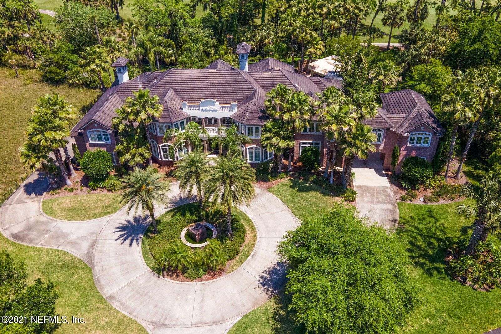 This Elegant Estate is designed for the owners who love privacy  Only 4 other homes share the cul de sac location.  Entering the grand foyer, you will overlook the Rotunda, one of the many delights you will see while touring the one of a kind home. On the left, is the formal dining with an included, unique granite table.  A walk-in wine cellar and butler pantry makes entertaining easy. Next find the showcase dream kitchen and gathering room.  Step out to the Resort Style pool w/Baja Sun Shelf, Swim-up Bar, Summer Kitchen and Waterfall. Relax indoors in the fireside Library/Game Room.  Continue on to the master suite wing.  More Marble, Granite, Onyx and Hardwood. 2nd floor left is an apartment suite, 2nd floor right is the theater wing.  3 more bedroom suites complete the the 2nd floor. The home's locale is on the 10th fairway. The golf cart is adjacent to the lovely woodsy rear of the home.  Marsh Landing Club is just step away. Welcome to Home!