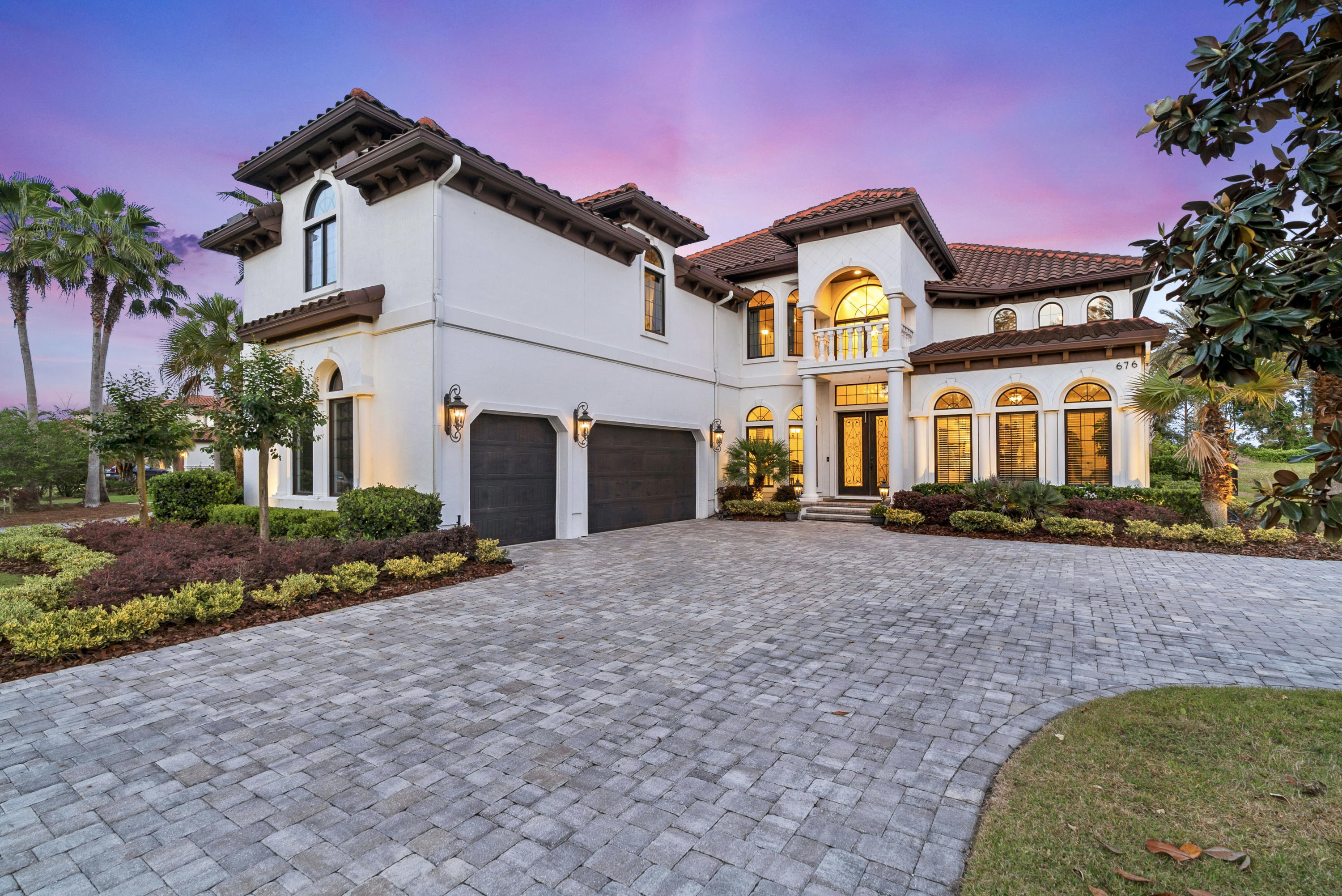 "THIS IS YOUR DREAM HOME! Breath taking sunrise & golf course views from this 5 bed/ 6 bath custom designed pool home. Luxuries Include: Grand foyer accented by a spiral staircase, formal dining rm, office w/ French doors & coffered ceiling. Rich scraped wood floors. An epicurean's dream kitchen featuring Wolf & Subzero appliances, designer cabinets w/ Viatera quartz countertops, hammered copper deep sink & hood vent. 1st & 2nd level master suites.The main level boast a Mediterranean styled bath & luxury shower. Lg. coffered high ceiling family room. 2nd level spacious spare bedrooms. Loft /Play Rm w/ Balcony golf view. Recreation/ Theater Room.  Backyard is ultimate playground spotlighted by the custom heated salt water pool & spa. Putting green & spectacular covered detached Cabana & bar                          ADDITIONAL HOME FEATURES  "" Nearly 5400 ft.² Of Air Conditioned Space  "" CDD Bond Paid In Full. Low annual Maintenance Fee  "" Decadent Custom Designed Master Closet  "" Control 14  Home Automation  "" Whole House Generac Natural Gas Generator  "" Plygem Mira Aluminum Casement Windows  "" Over 4000 ft.² of Travertine Pool & Lanai Decking  "" Oversized Custom Spa & Pool (Heated)  "" Outdoor Summer Kitchen/Cabana With 3 Commercial Heaters.   "" Extra Storage space for Golf Cart Storage.  "" Twin WIFI Controlled Gas Accent Torches  "" Custom Built Cabana & Entertainment Space that can seat up to 20.   Extended/ Summer Kitchen    "" 4 Hole Custom Putting Green  "" Fenced Rear Yard  "" Heavy Glass Door Sliders  "" 3 Tankless Water Heaters  "" 16-SEER Comfort 2-Speed HVACS  "" Remote Shade Control Blinds  "" Scraped Harwood & Custom Tile Flooring  "" Open Cell Foam Insulation  "" 300 Foot Deep Artesian Well For irrigation  "" Custom Landscape Lighting  "" Pergola With Teak Swing  "" Fire Pit  "" Long Courtyard Styled Pavered Driveway  "" 3 Car Garage With Overhead & Cabinet Storage   ""Central Vacuum System  Custom Fixtures & Lighting  "" Soft Close Designer Kitchen Drawers & Custom Cabinetry  GREAT COMMUNITY AMENITIES  INCLUDING:  Nature Trails And Boardwalk to the Intracoastal  Opportunity to Join An Arthur Hills Signature Design Golf Course & Club  Tennis, Pickleball, Parks, and Soccer Fields  A Rated Fitness Center with Lap Pool  Recreational Pool With Slide   Premium Name  Grocery Shopping and Dining In The Neighborhood  A rated Elementary School In The Neighborhood."