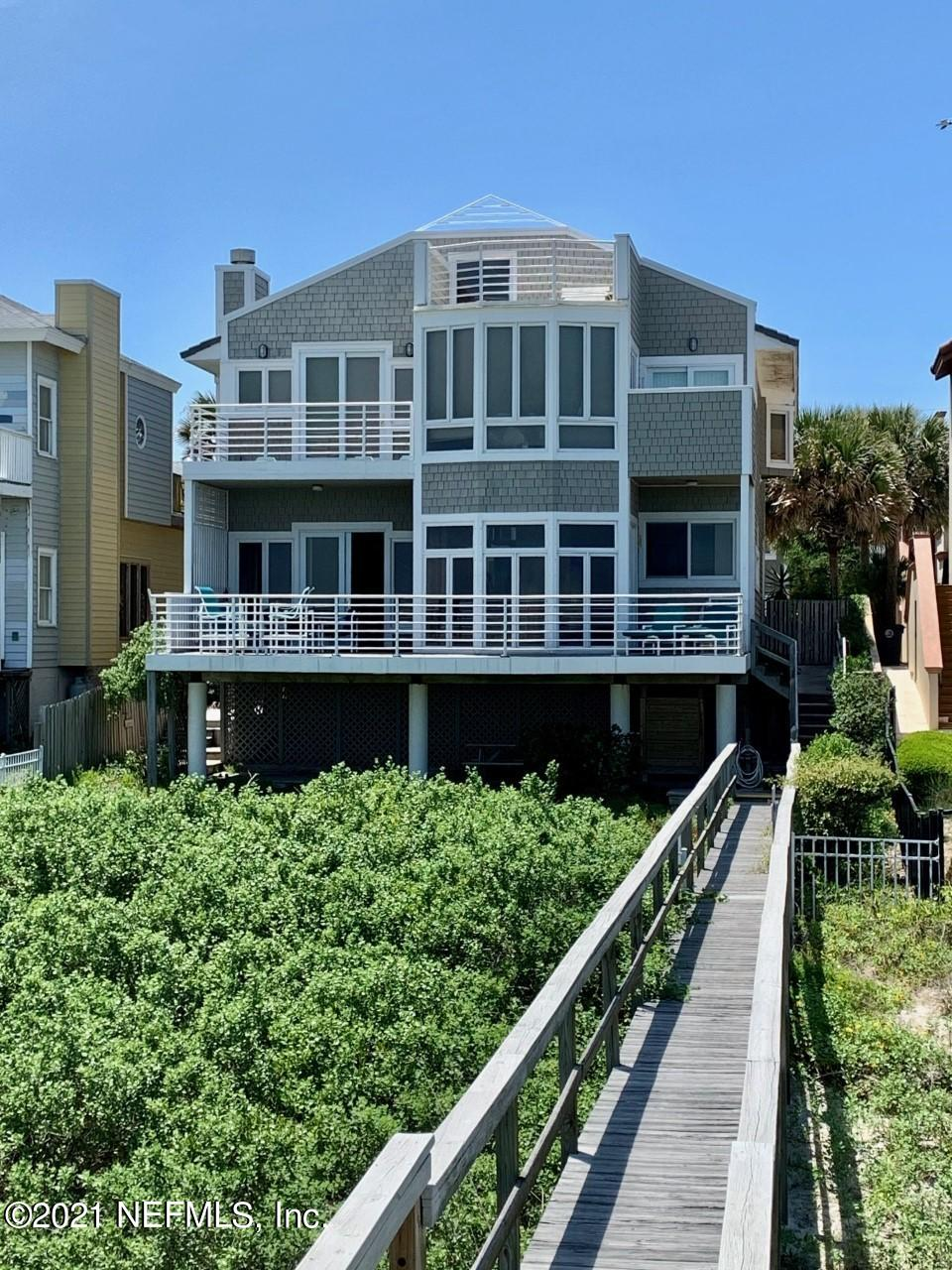 Welcome to this 2 story Cedar Shake oceanfront oasis with expansive water views in the coveted community of Atlantic Beach. Walk out the balcony doors to stunning sunrises, and dolphin pods swimming by. Natural light fills this 3 bed, 2.5 bath home. Sweeping ocean views continue into the kitchen. Ten-foot high ceilings in family room, generous breakfast area, cocktail wet bar, and courtyard pool/spa offer the ultimate exclusive beach lifestyle. Home has 2 fireplaces, 3 balconies, oversized owners suite with vaulted ceilings, sitting area/flex space, access to crow's nest, steam shower, 3 walk-in closets, and 2nd floor laundry. Ground level covered backyard picnic/game area and private outdoor shower and private boardwalk to the beach. Included on property is a 1 br/1 bath carriage house with full kitchen, can be income property as it has separate utilities. 3 car garage-1 bay is set up as a cabana with sliding doors to pool. Half bath and wet bar for entertaining in pool area. Both main home and carriage house have cement tile roof replaced in 2020.    Head down to the beach for a stroll to the town center shops and restaurants, and chat with neighbors along the way. This home is built on solid pilings. A must see!!
