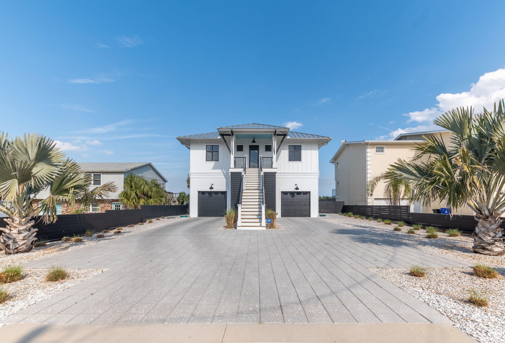 A celebration of the ocean, light, and air, this extraordinary property is bold in modernity and uncompromised in luxury. This masterpiece was built in 2019 with magnificent ocean views, architectural brilliance, and the highest levels of design and artistic craftsmanship. Located just minutes from downtown St. Augustine, this home is complete with a deck spanning the entire 2nd floor and oversized sliding doors. A sun filled and state of the art entertainer's dream kitchen with Wolf range, Subzero refrigerator, wine fridge, Caesar stone counters, and expansive quartz waterfall island with bar seating opens into the living room with high ceilings. Wake up in the master suite overlooking the deck and exquisite direct ocean views.