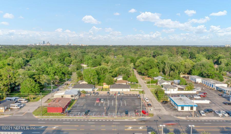 Prime real estate located on major artery of Cassat Ave, just off I-10 on car row w/ anchor dealerships Chevrolet, Ford, Toyota, Honda and Hyundai!  Sale includes 4862 Louisa Ter (Parcel #: 066382-0000) zoned CCG-2 for a total of 2,735sf under roof and a 100-car capacity!  3 car garage for detailing, auto repair, or covered parking.  Acreage must be verified.  Expect more visibility - 180' frontage on Cassat Ave w/ an average of over 23,000 traffic count daily!  New features include 50-year metal roof, coated asphalt, auto lighting w/ motion sensors, security system & cameras.  New paint & carpet throughout.  Parcels span 2 corners - Louisa & Headley -- a real moneymaker!  The possibilities are endless to divide the lots and create 2 businesses!  By appointment non-business hours only.