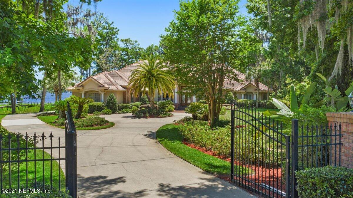 Gorgeous Riverfront estate home on 2 acre Lot with 240 feet of river frontage.  This magnificent home offers the ultimate lifestyle for boating, skiing, kayaking,            fishing, & other water sports with its Dock, boathouse, & pilings for a yacht.  Enjoy a beautiful screened pool plus large yard for activity. This stunning custom built home is open & airy with river views from most rooms. The home has  gorgeous high coffered & tray ceilings plus 3 fieplaces & incredible woodwork.  The 1st level has a formal livingroom, diningroom, familyroom & kitchen along with a stunning Primary suite & an Office/5th bedroom with its own bath. The 2nd level has 3 bedrooms plus a loft/bonus room perfect for games &TV. Indoors & outside this estate is designed for Family living & entertainment