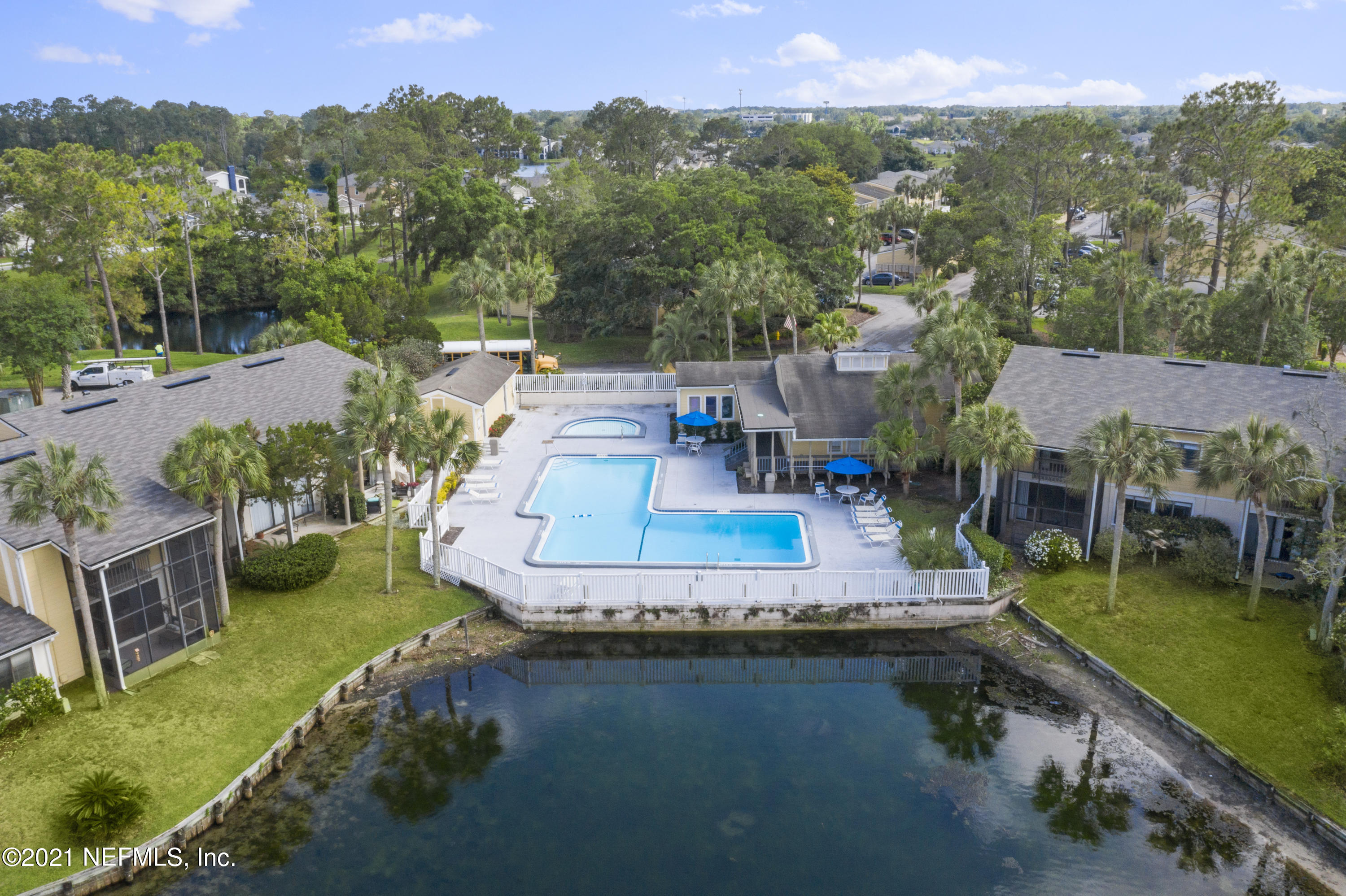 Ground floor 2 bedroom / 2 bath condo in quiet well-established Baymeadows community. Prime location overlooks green space, mature landscape and plenty of privacy. The home has been updated with new AC, newer water heater (2019), laminate floors, and updated bathrooms.  Large, over-sized bedrooms, adjoining bath in master, inside (enclosed) laundry and flex space for storage or to convert into a small office create well thought out living spaces. The spacious screened patio offers lovely views and access from both living and dining areas. This home includes a carport and storage area conveniently located near the unit.  Community amenities include clubhouse, pool, children's pool, nature trails and a dog park. Association fees include water, sewer and daily trash pick up from your door. This incredible location is convenient to shopping, restaurants, schools, major through roads and employment centers.