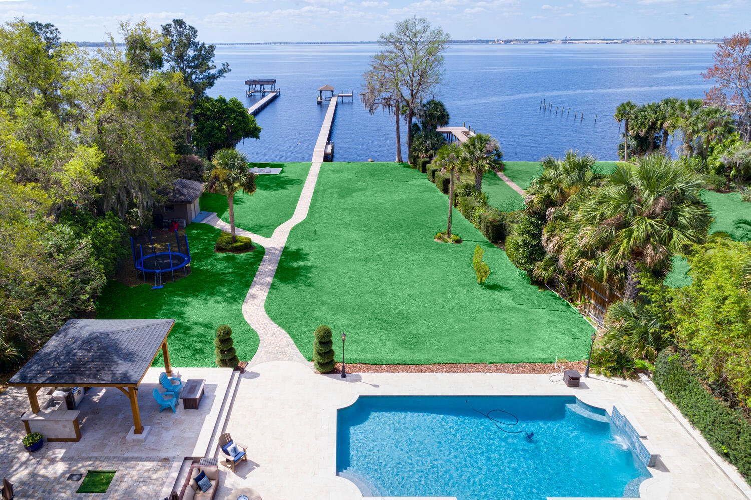 WELCOME TO RESORT-STYLE LIVING!! Stunning and spacious home perfectly nestled on a deep St. Johns River lot just one block north of The Bolles school! Complete with newly renovated kitchen, master suite and bathroom with steam shower. BRAND NEW ROOF, newly rebuilt dock complete with boat lift. New luxurious state-of-the-art, heated pool w/ LED lighting with patio & summer kitchen - everything you need to entertain or spend your afternoon watching the beautiful sunset in the comfort of your own waterfront sanctuary! Updates galore, including kitchen, flooring, electrical, plumbing, windows, HVACs and much more! Please see attached list of improvements. Unique opportunity to own a private riverfront estate with a deep lot; must see to appreciate!