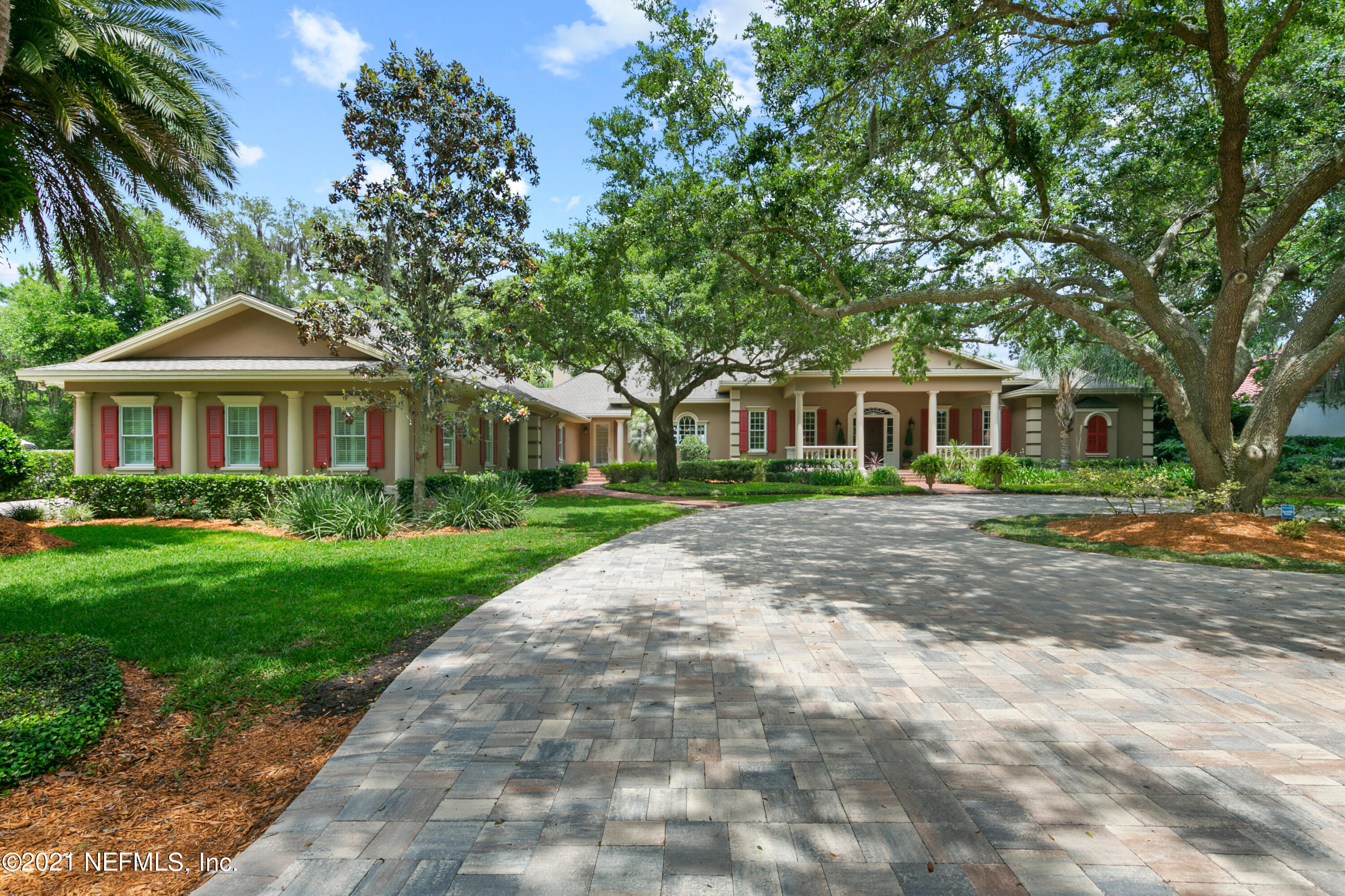 Welcome to Queens Harbour! The ultimate in Florida living. Boating, Golfing, Swimming and Tennis. There is no  place like it. Your future home is a Custom Built Low Country  Estate. Originally designed and built as the Developers personal home. Situated on 1.2 acres waterfront. He hand picked the finest lot, covered with  mature Oaks that offer shade to compliment the cool breeze of the water. 5 Car Garage, New Wolf  appliances, Granite counters. Paver drive, custom mill work, custom Bar, Large gathering room, 2 living rooms. This home is an entertainers dream.  Recently added an extraordinary  owners bath and custom closet  in which  no detail was overlooked. Heated floors, electronic revolving  shoe rack. There are too many custom features to list. Every bedroom enjoys an on-suite bath