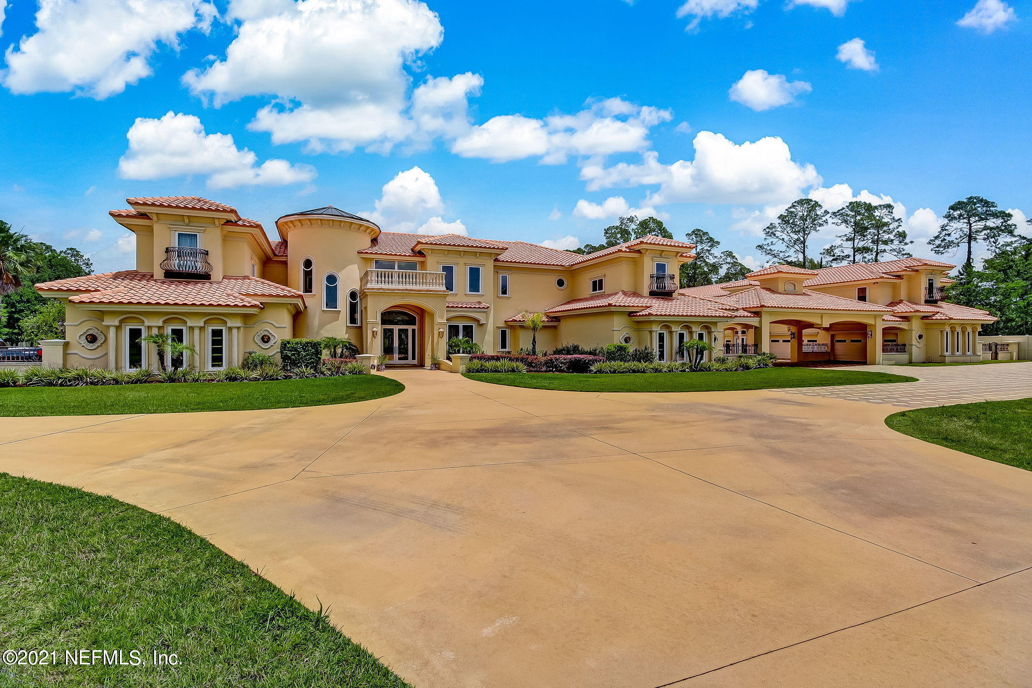Truly remarkable and rare 9 acre gated estate offers 11,000 sf home w/ 3,500 sf guest house w/ resort-inspired 7,000+ sf enclosed pool & patio area and six oversized 2 car finished garages to showcase your collection. This well built custom home is designed for large family, multi-generational living & entertaining! The main house offers 11,000 sf of beautifully finished living spaces, a stunning owner's suite + 5 additional bedroom suites each with private ensuite baths, private executive office, theater or lounge, one of a kind ''Man Cave,'' balconies, incredible resort-inspired enclosed pool + two 2 car garages. The ''Guest House'' offers an additional four oversized 2 car garages with a 3/3 guest house & studio apartment located over the garages. View video and photos for more details!