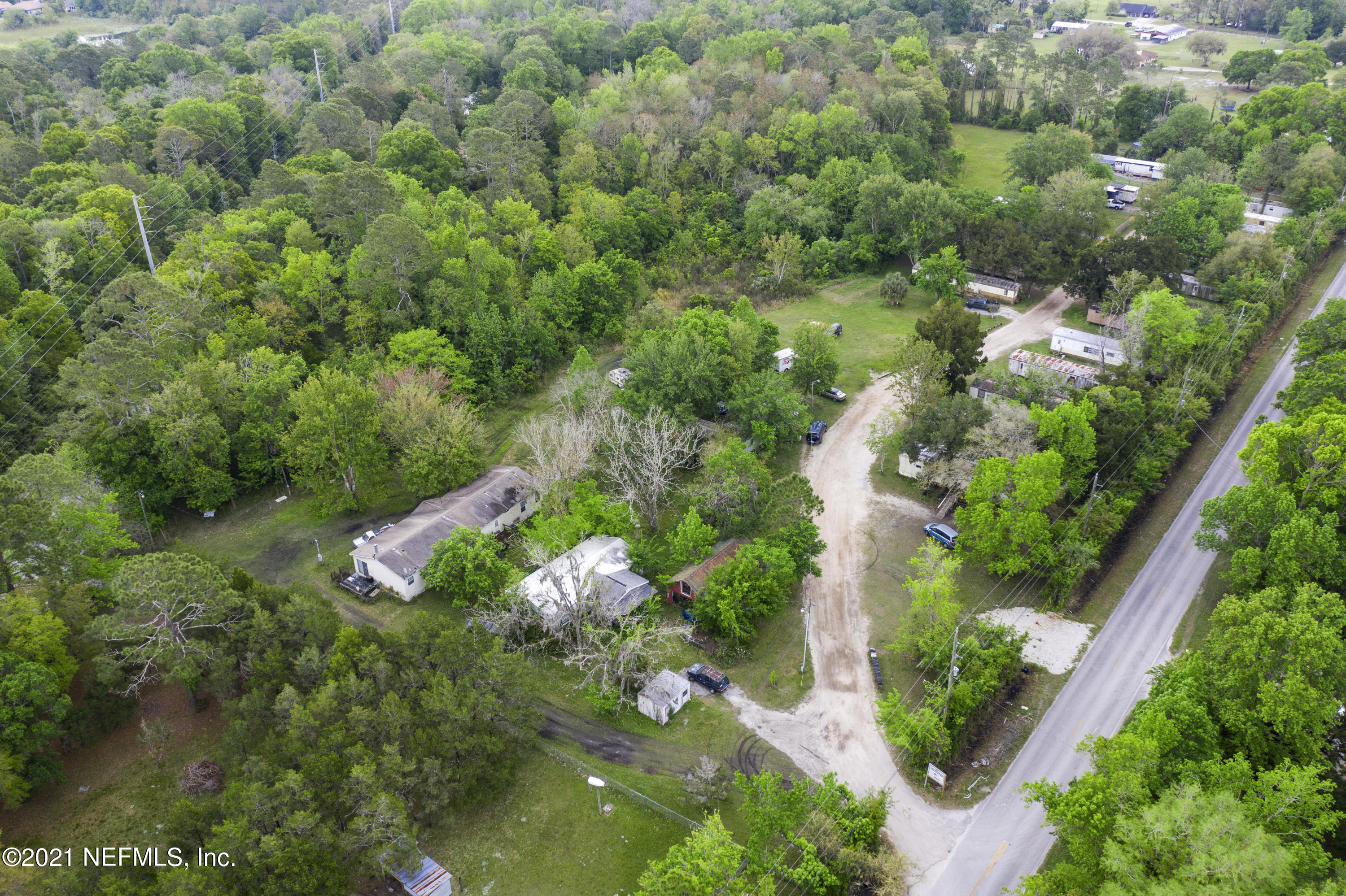 Property in Opportunity Zone! 3.873 Acre Mobile Park with 19 total lots in opportunity zone! 15 of the mobile homes are owned by the property owner. One unit is being used as a storage shed and 3 other units are being leased out for lot rent. All units have separate electric meters. All land of the 3.873 acres is high and dry. Inquire for more information. The land can be rezoned and the new owner can speak with the county about redeveloping. This property is being offered separately or in conjunction with the adjacent parcel at 2021 Four Mile Rd.