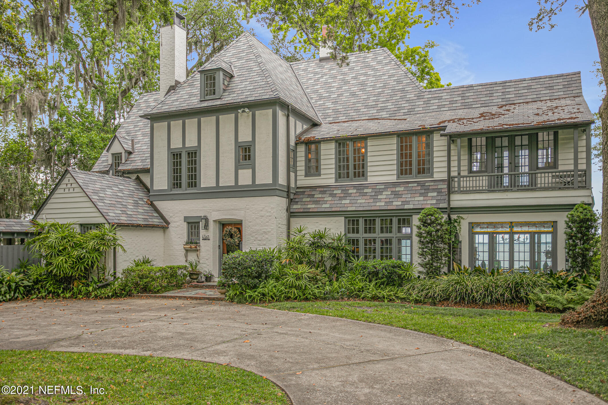 This classic manor has all the charm and character you would expect from this 1930's beauty. Custom-built as a Tudor estate and designed by famous American archiect, Melen Greeley. This home is a Jacksonville treasure with panoramic views of The St Johns River from every room. The three floors of living spaces are filled with timeless and rich details from flooring, doors, windows and moldings; including the detached guest suite, counted in the sq. footage. Current owner has modernized ALL the main components: NEW UPSCALE ROOF, NEW ELECTRICAL WIRING, NEW PLUMBING, NEW BATH FIXTURES BY HOLLINGSWORTH, NEW PAINT ON EXTERIOR & INTERIOR. Nestled between the Florida Yacht Club and Timuquana Counry Club, experience the Jacksonville lifestyle at its best. Clubs so close; hop, skip or float....