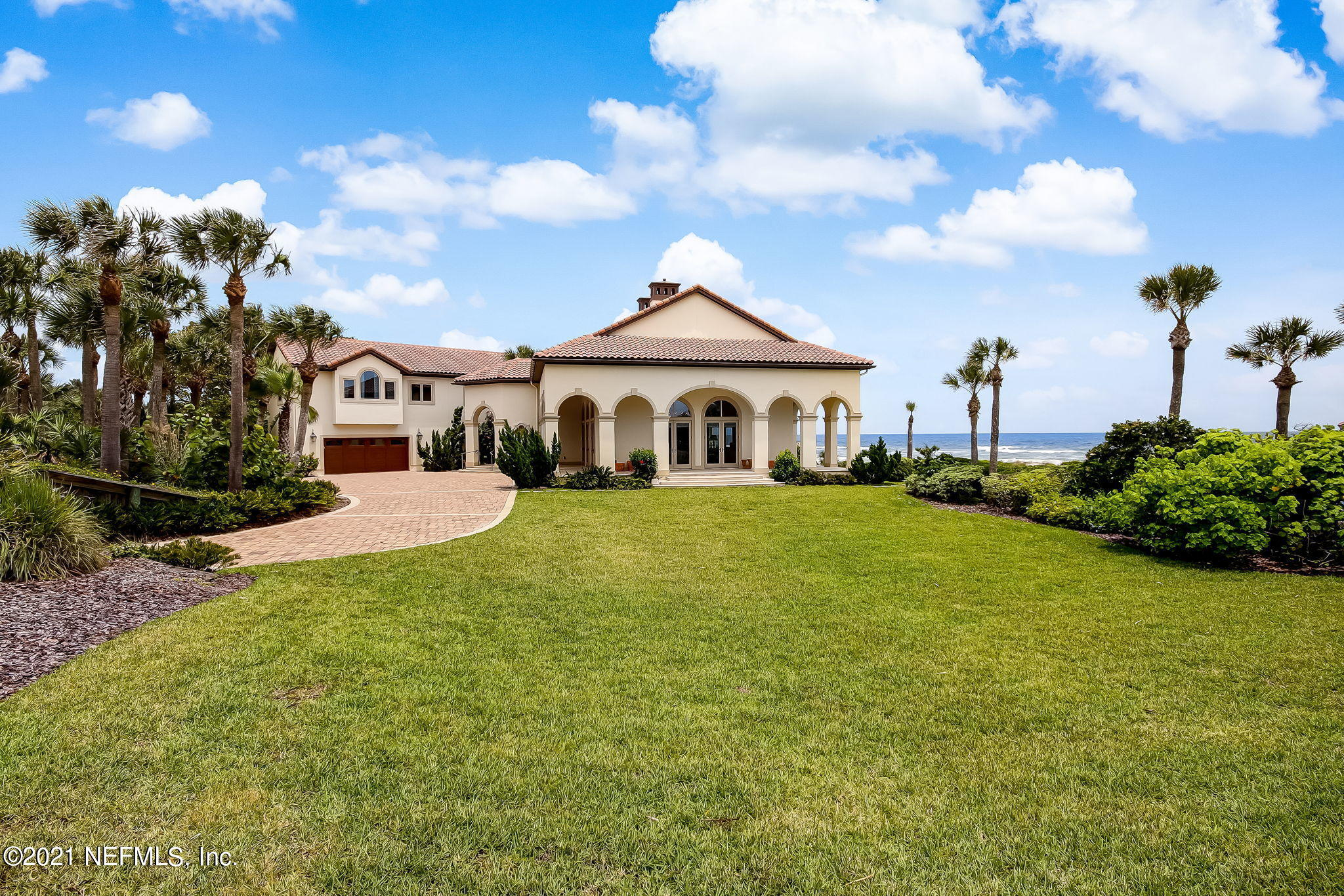 Enter this gated estate and be blown away by the magnificent house, sweeping green lawn, sparkling pool and the expansive ocean view. This  amazing lot has everything  a buyer could wish for located on the ocean in prestigious Ponte Vedra Beach.  Lightly lived-in, the house shows like a model and takes advantage of the ocean views from every room on the 1st and 2nd floors. All furnishings are available for purchase separately.