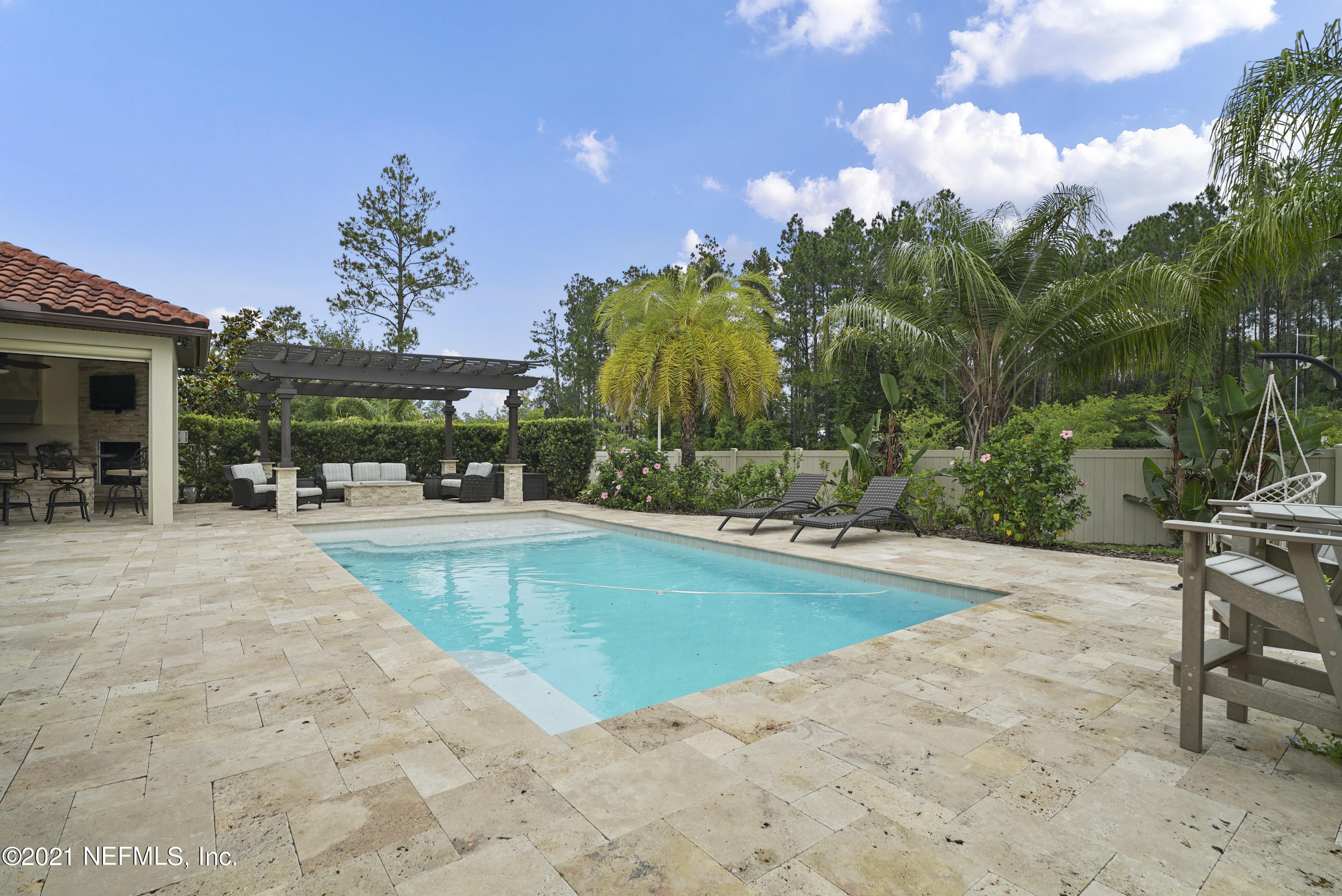 One of a kind, custom ICI built, POOL HOME in Nocatee's only gated 44 home community that is in close proximity to Valley Ridge Academy K-8 school. Courtyard entry with a unique, customized, split floor plan. This stunning home offers dramatic high ceilings which provide a grand entry foyer connecting the great room to the large kitchen and dining space. Enjoy entertaining inside and out -- custom wet bar and built in cabinetry in great room plus focal point fireplace. When you want to take the party outside, flow through the covered lanai and take a seat at the bi-level bar, grill out in your summer kitchen, and enjoy the fireplace and outdoor TV! Pool with travertine deck, pergola and gas fire pit. Covered sitting area with motorized, retractable screen. Master enclave with seating area plus large master bath, dual closets with custom organizer system and private access to the pool. Large windows beaming with tons of natural light throughout the home. 4 additional guest rooms, 2 guest baths (one ensuite) and additional dedicated office space with cabana bath access. Powder room for guest convenience. Lots of extra in this amazing home, including Spanish-style tile roof, details like crown moulding, rounded corners, surround sound system, plantation shutters throughout, built in bench seating, 10ft doors, laundry room with utility sink and cabinetry. Please see documents for additional info.