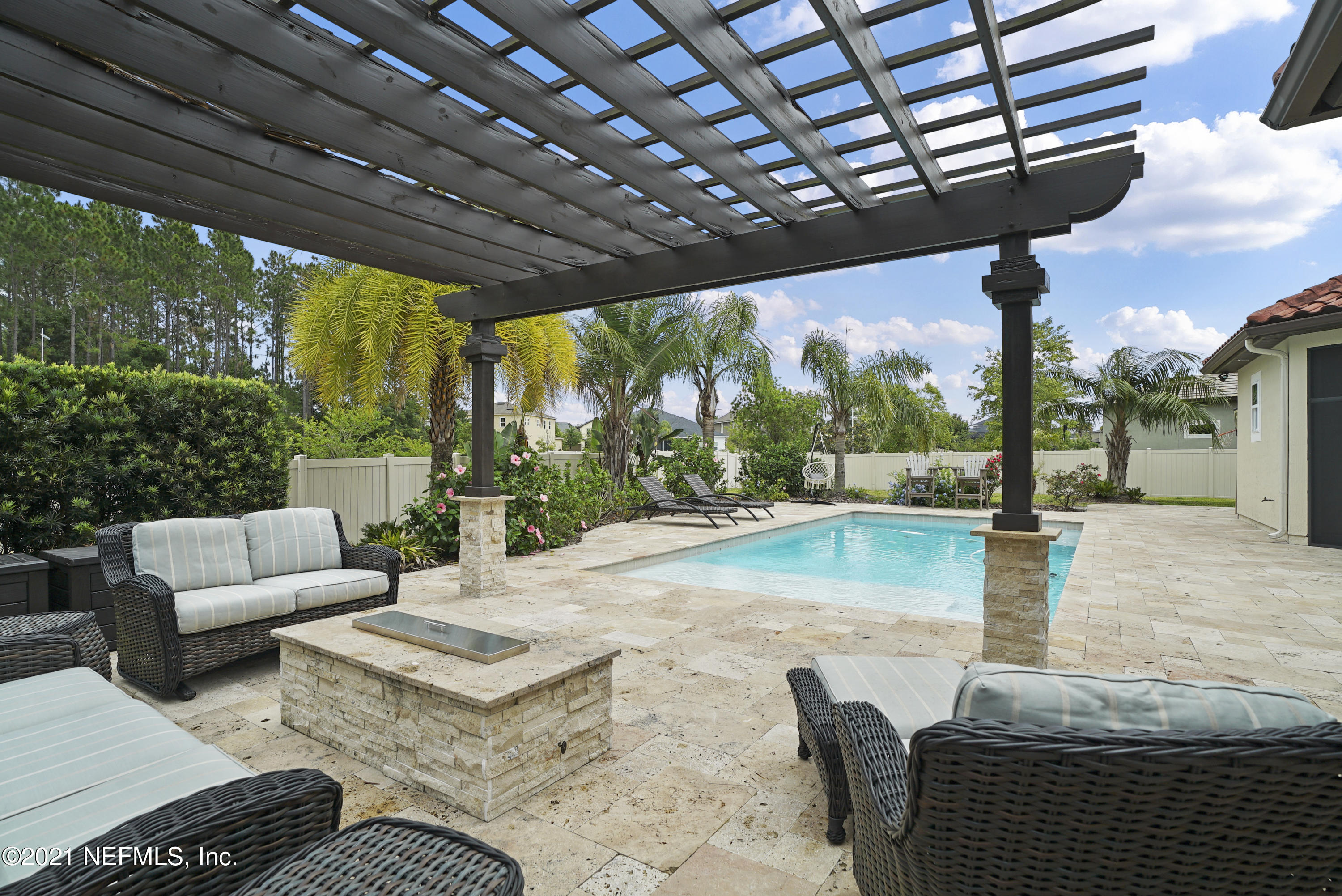 One of a kind, custom ICI built, POOL HOME in Nocatee's only GATED 44 home community that is in close proximity to Valley Ridge Academy K-8 school. Courtyard entry with a unique, customized, split floor plan. This stunning home offers dramatic high ceilings which provide a grand entry foyer connecting the great room to the large kitchen and dining space. Enjoy entertaining inside and out --  custom wet bar and built in cabinetry in great room plus focal point fireplace. When you want to take the party outside, head to the Outdoor OASIS. Enjoy the covered lanai and take a seat at your bi-level bar, grill out in your summer kitchen, and enjoy the fireplace and outdoor TV! Pool with sundeck, travertine deck, pergola and gas fire pit. Lanai can be enclosed with motorized, retractable screen. Master enclave with seating area plus large master bath, dual closets with custom organizer system and private access to the pool. Large windows beaming with tons of natural light throughout the home. 4 additional guest rooms, 2 guest baths (one ensuite) and additional dedicated office space with cabana bath access. Powder room for guest convenience. Lots of extra in this amazing home, including Spanish-style tile roof, details like crown moulding, rounded corners, surround sound system, plantation shutters throughout, built in bench seating, 10ft doors, laundry room with utility sink and cabinetry. Please see documents for additional info.