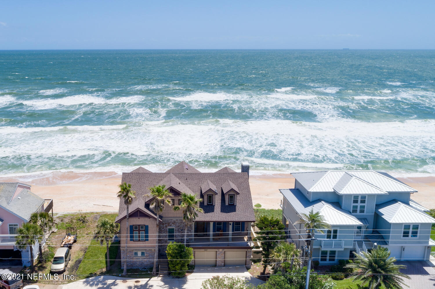 Stunning oceanfront estate with expansive views from nearly every room!  Main living space is on the 2nd floor with huge living & dining combo with beautiful river rock fireplace.  Enjoy the chefs kitchen with Thermador appliances!  One of two master suites is also located on the main floor.  1st Floor includes 2 more bedrooms,  kitchenette, laundry room, game room, wet bar, cabana bath.  3rd Floor has another beautiful master suite with private balcony, 2 other secondary bdrms.  Home is complete w/ 2 car garage and elevator.  Backyard space includes oceanfront fire pit, and more lounging space to soak in the magnificent views!  Home is currently being used as a vacation rental with awesome income - or enjoy this as a perfect family retreat!! BRING ALL REASONABLE OFFERS!