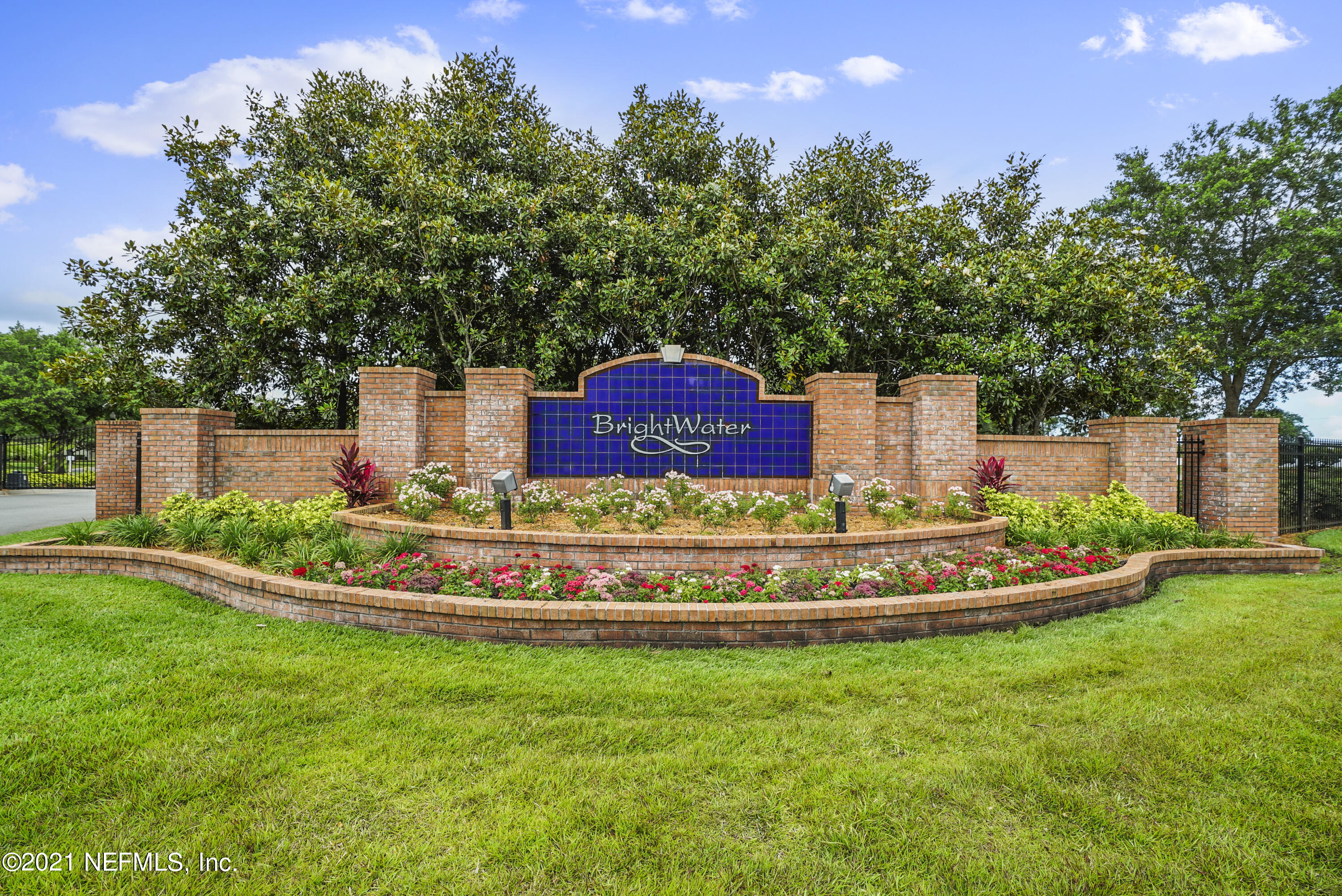 Welcome Home to this great property in the highly sought after, gated community of Brightwater. This townhome features a dynamic pond view, top of the line kitchen selections in cabinetry, counters and backsplash; updated lighting and fixtures throughout, hardwood laminate floors and desirable location near the amenities & pool. The open floor plan works well for entertaining with the downstairs living space & kitchen overlooking the screened lanai. You will enjoy the stackable sliding doors that open up completely making the lanai feel like an extension of the living space. The 3 upstairs BR's are split making it a perfect set up for company or a roommate. This gated community is in an excellent location close to the St Johns Town Center, shopping, restaurants and interstate access.