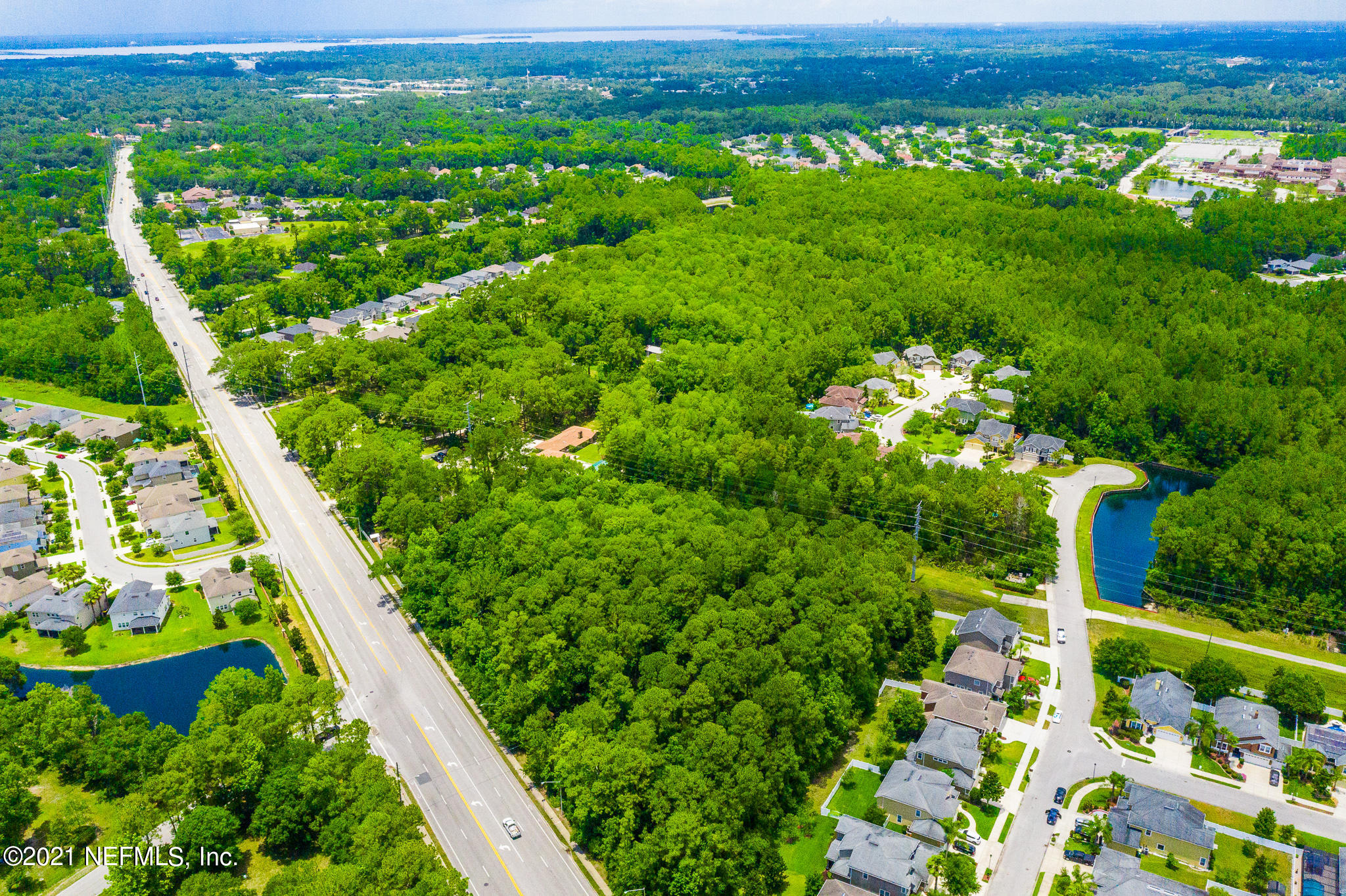 An outdoors person's Dream, or a Developer's diamond in the rough. Sale includes 2 properties 11999 Frenchie Ln and 12265 Old St Augustine Rd. Approximately 13+ acres with 2 ponds, located in the highly desirable Mandarin area off of Old St Augustine Rd. 11999 Frenchie has a 5 bedroom 3.5 bathroom home, with a detached office/entertaining bonus structure complete with a full outdoor wet bar. Relax the day's stress away in the spa inspired master bathroom as you soak in the deep jetted tub or get energized for your day in the walk-in custom shower, complete with every fashion lover's dream closet a few steps away. 12265 Old St Augustine Rd has a 1 bedroom 1 bathroom home, remodeled interior, that would be perfect for a mother in law suite, or rental income producing property. If you If you enjoy nature look no further, this is the property for you! If you are looking to develop the land into the next up and coming neighborhood then you have found the gem you've been searching for!