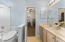 This bathroom is conveniently located between bedrooms 2 and 3. Shower tub combo.