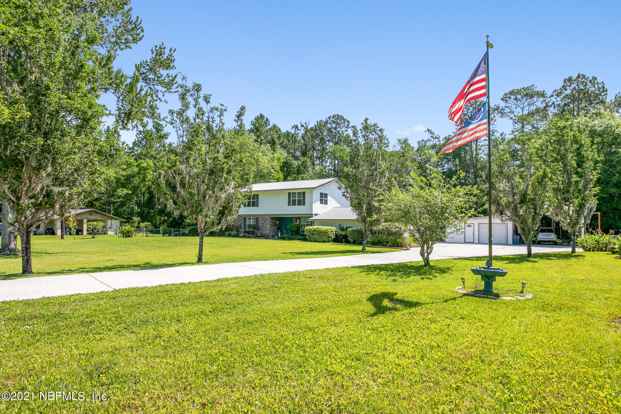 Here's the country charmer that you have been waiting for!  Enjoy privacy on your huge 1.06 acre lot with a beautiful pond.   Updated kitchen is open to the large living room with fireplace and half bath on the first floor.  Nice private office and formal dining room are just around the corner.  There are 3 large bedrooms (split) upstairs with large walk-in closets and 2 full baths.  Huge back deck with summer kitchen for summer party enjoyment.  Also, there is a detached garage which could be used for a man cave or workshop in addition to a large carport which can hold an RV.  There is also  another detached shed/pump house which could have many uses.  New metal roof and electrical panel plus complete rewire of detached garage in 2020.  Come see this beautiful home before it is gone Detached garage has 2 window AC/heat units.   Septic system recently pumped.  Rainsoft water system.  All air ducts cleaned 2019. Pond/dugout cleaned 2019.  New culvert put in 2019.