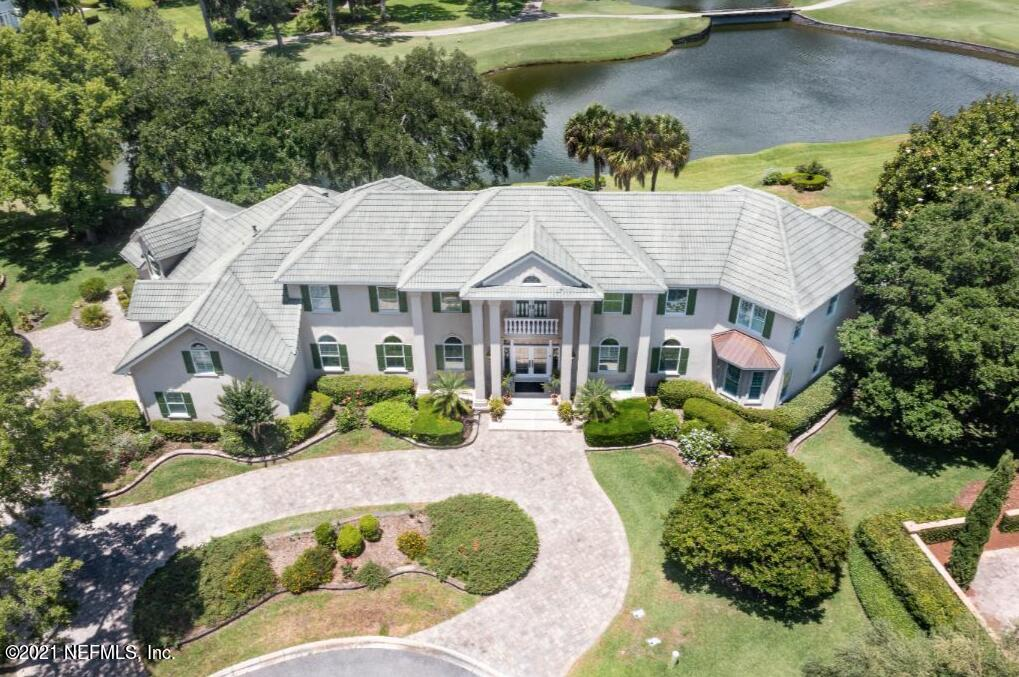 Enjoy the Florida lifestyle at it's finest! This custom built home was carefully designed to take advantage of the stunning water views afforded by its premium location overlooking water and the #3 hole on Plantation's championship golf course. This amazing 2 story majestic home was designed with the finest attention to detail. When you enter the home, you will enjoy the large floor to ceiling windows situated in a great room with soaring ceilings. Designed for entertaining, this home has expansive indoor and outdoor living spaces, all of which overlook a covered lanai & screened enclosed pool. A downstairs master retreat features two separate full bathrooms, ample closets and lots of storage. With an additional 6 guest rooms, (5 en-suite), there is plenty of room to accommodate family.