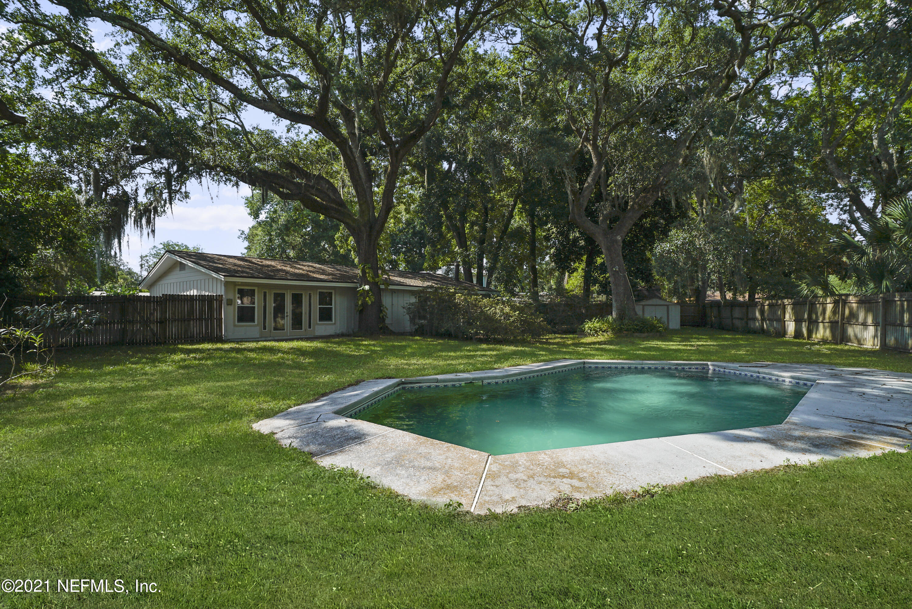 Are you looking for a BEACH HOME with a POOL? Don't miss out on an opportunity to make this beaches original your private enclave. Located in one of the largest 'neighborhoods' of Jax Beach, you will enjoy the convenience of living a short bike ride to the beach AND ALSO having a true neighborhood feel. NO HOA means you can park your boat, RV, toys, etc. One of the largest lots available at the beach and plenty of room to expand. NEW ROOF has been installed in last 2 months. Exterior just repainted. 2 sheds located out back. Large circle drive. Floor plan can be altered to add an additional 4th bedroom. Plumbing redone. Artesian well for irrigation/heat pump. So many options that make this an attractive deal! After reno, home value almost $700K based on comp sales! OPEN HOUSE Sat 11-1pm