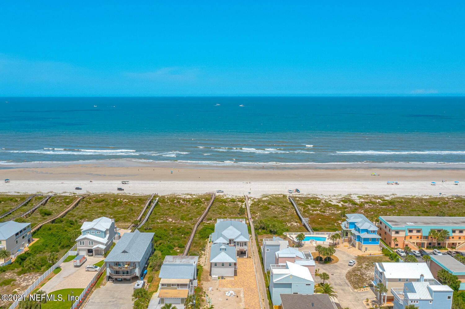 Beautiful panorama direct ocean front pool home on St Augustine Beach.  Gorgeous home features 7 bedrooms and 5 bathrooms. This home is equipped with an elevator. The home has oversize gathering room with a gas fireplace. Home features wood flooring, with the most upgraded lighting throughout the home. Picturesque kitchen with grand island/granite counter tops. A sub-zero refrigerator integrated within cabinetry.  Gas range with downdraft, dishwasher, spacious pantry and wet bar area. Formal dining room overlooking the ocean. The home features laundry room and full bathroom downstairs. Gorgeous staircase leading up to spacious family room/bedroom. Owner suite has ocean front view with fireplace. Ensuite has oversize closet (16x8) double shower with two entries.