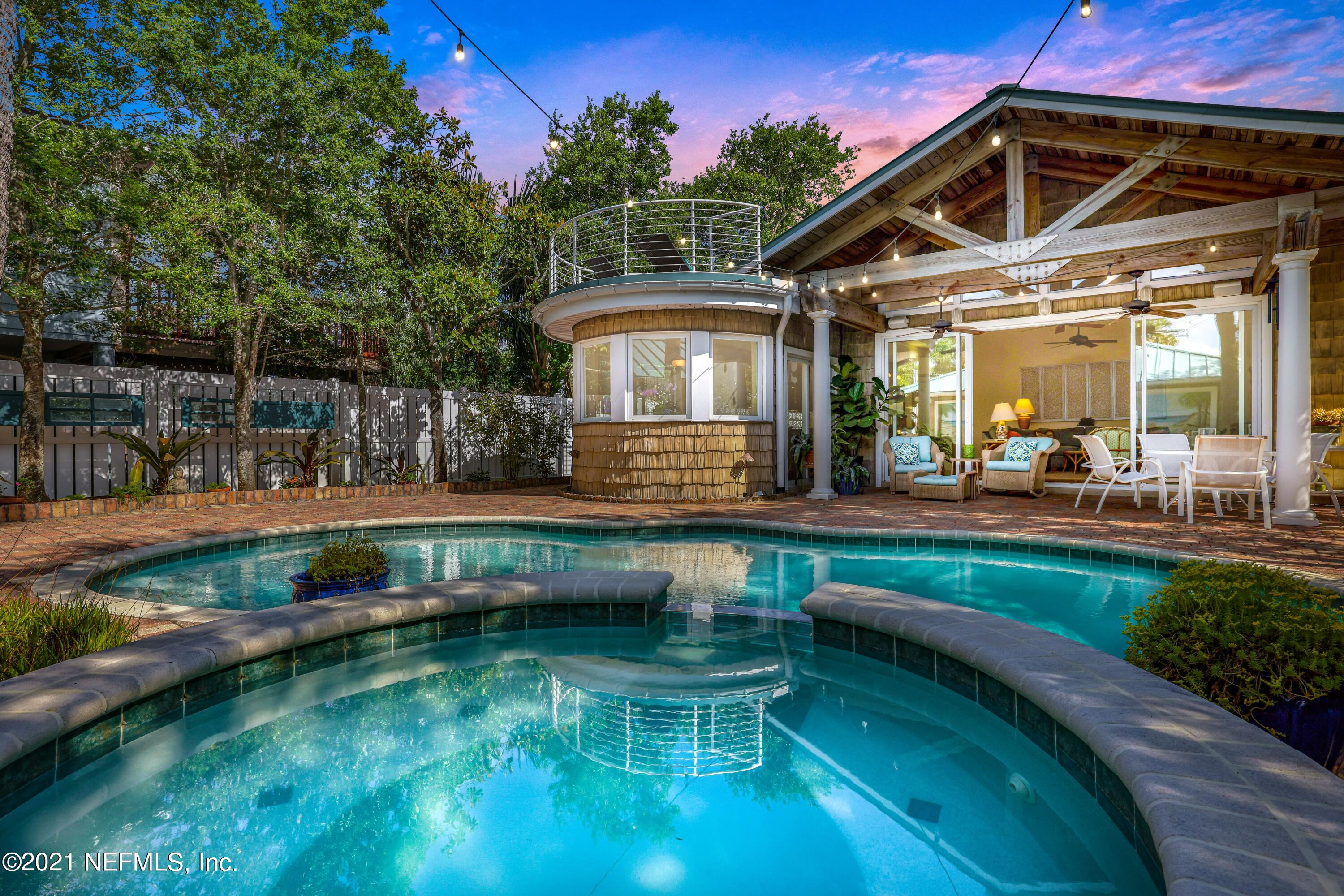 """Welcome to ''The Oasis'' on Walnut St in Neptune Beach.  A One-of-Kind, Custom, Quality Constructed, Well Maintained, Private Seclusion East of 3rd Street is Just Steps to the Ocean & the Desirable Beaches Town Center. At 2,600+ Square Feet with 3 bedrooms & 3.5 bathrooms, This Vintage Property was Taken to the Studs & Totally Renovated in 2003 Adding a Great Room, Kitchen, Laundry, 2.5 Car Detached Garage w/Attic, Saltwater Pool, Outdoor Shower & Full Pool Bath. An Entertainers or Family Fun Dream Layout with Oversized Sliders Leading from the Great Room to the Covered Lanai & Pool Courtyard.  Nestled in a Lush Tree Canopy on an Oversized 50' x 135' Lot, this 30s Style Coastal Home Offers Privacy in an Urban Setting with Low to No Maintenance. No Grass to Cut, Just Florida Friendly Landscaping w/ Well Irrigation System Making Way for Time to Enjoy the Beach, Walk to """"The Corner"""" or Ride Your Bike Enjoying All the Beach Lifestyle Has to Offer! Honey Maple Shaker Glazed Cabinetry throughout with Brushed Bronzed Hardware. Quartz Countertops & Windowsills. Kitchen-Aid Stainless-Steel Appliances. Natural Wood Trim Baseboards & 2 Panel 30's Style Doors.  Built in Entertainment Center with Bookshelves, Cabinets and Wet Bar.  Gorgeous Tongue and Groove Pine Wood or Bead Board & Beam Ceilings in Great Room, Sitting Room, Office, Primary Bathroom & Open Lanais. Note the Faux Painted Speakers, Lights & Vents to Match the Wood Ceilings Throughout the Interior. The Upstairs Primary Suite has a Large Bedroom with Vaulted Ceiling, Sitting Room & Office/Flex Room with the Restored Pine Floors. The Bathroom has a Double Vanity and Oversized Shower with Jetted Spa Tub & a Custom Tile Inlay from Hibernia/Australia.  Large Walk In Closet with Organization System. The 2nd Story Lanai & Balcony has Trex Decking with Powder Coated Railings. Downstairs You'll Find Natural Oak Wood Floors in the Secondary Bedrooms with Large Walk-In Closets. Oversized Neutral Tile in All Wet Rooms.  Arlo S"""