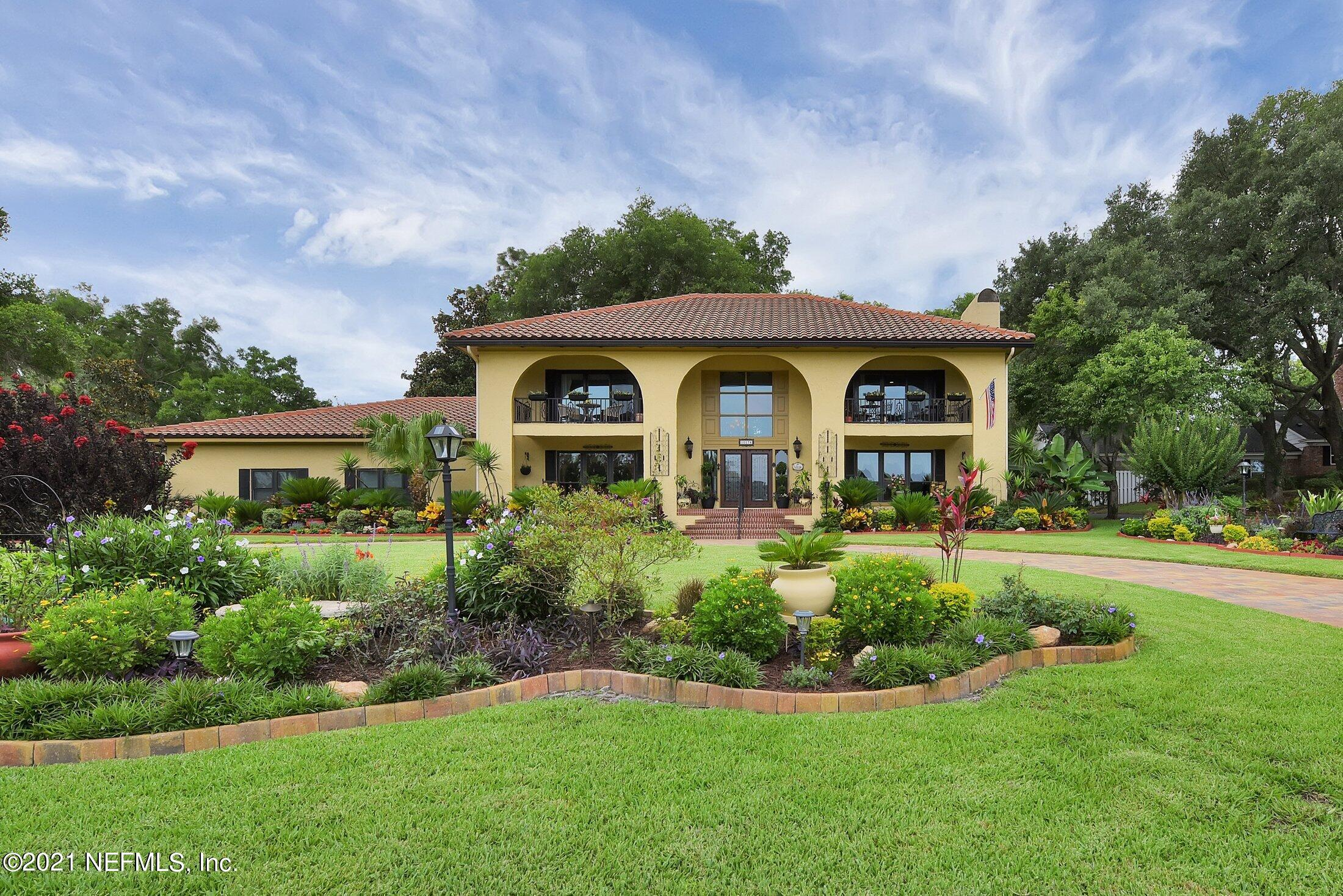 This unique and tranquil Mediterranean home is a labor of love by its owners. This home boast the most beautiful gardens in all of Deerwood coupled with the best lake view.  Sit on the front porch or balconies on the second floor outside the owner's suites and look out over Lake Mineral, Deerwood's only spring fed lake.  Home was taken down to the studs and completely updated in 2015. Home features an oversized 2.5 car garage with 2 seperate storage rooms and a workbench.  There is ample room for a pool in the backyard.  The community is gated with 24 hour security. The owners beautifully renovated  the interior and planted lush gardens creating a tranquil oasis you will want to call home. This spectacular concrete block home has so many new features.  New appliances, oversized island, soft close cabinets, rapid fire pump for quicker hot water to kitchen.  New travertine, marble and wood floors throughout. New windows, sliders, tile barrel roof (2018 w/50 year warranty) gutters, water softener, AC, hot water heater,  well for irrigation, electrical, and paved circular drive. Owner's suite has double occupancy tub with added heating system to maintain temperature while soaking.