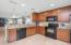Kitchen - Granite countertops and undercabinet lighting
