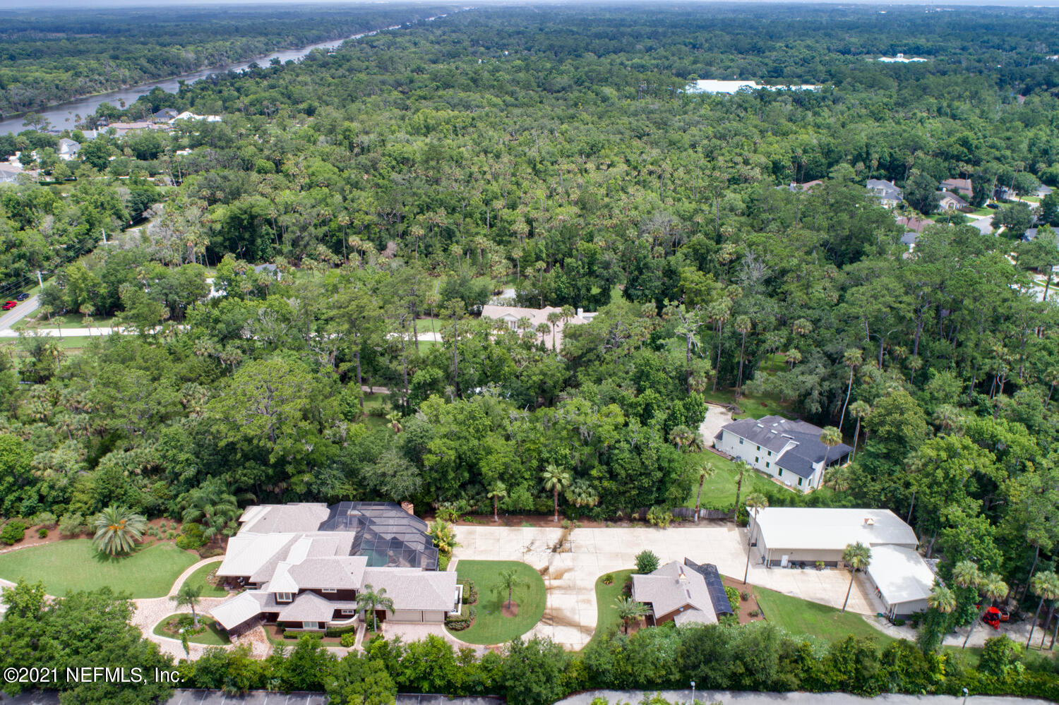 Must see in person to appreciate this 1 of a kind Mini Estate & compound on 2 acres w/a Main House, Guest House PLUS a detached 3550 sf warehouse/garage w/ 2-14', 2-12' & 2-10' garage doors, ready for your RV, boat, hot rod, motorcycle w/insulated walls & ceiling. Main house is 4025 sf, 5 beds/3.5 baths, office. Chef's kitchen w/quartz countertops, Thermador gas 6 burner cooktop/oven, plus Thermador electric oven, Thermador fridge, Bosch dishwasher, Miele coffee system, wine cooler, 3 sinks, butlers pantry, ice maker & custom pecky cypress cabinets. Guest house is 888 sf, 2 beds/1 bath, full kitchen, washer/dryer, 2 screened porches. Fully screened outside oasis includes: sauna, steam shower, fireplace, covered dining/seating, heaters, pool, hot tub, ice maker, 1/2 bath, fridge & speakers