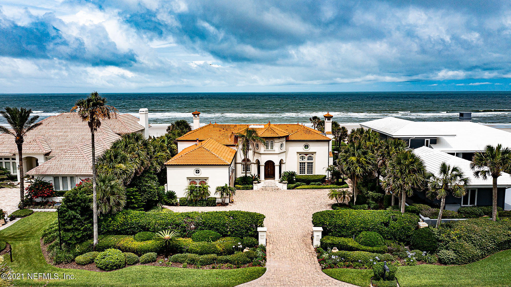 Presenting a rare find on the Ponte Vedra Beach Oceanfront. This is a lifestyle location just minutes north of the Ponte Vedra Inn & Club with the beach in your backyard and golf views in your front yard. A Palm Beach/Spanish influenced design, this home has a grand entry with two story ceilings in most shared rooms, spacious oceanfront pool, stone deck, large yard, and covered lanai with gas fireplace. Impressive craftsmanship is featured throughout the home: Beamed and coffered ceilings, custom Cypress paneling and detailed finishes. The eat-in kitchen has custom cabinetry, built-in coffee bar, buffet and large center island. Enjoy views from the first floor oceanfront owner's suite. Find four bedrooms plus a flex room on the 2nd floor. An unsurpassed opportunity in an impeccable setting