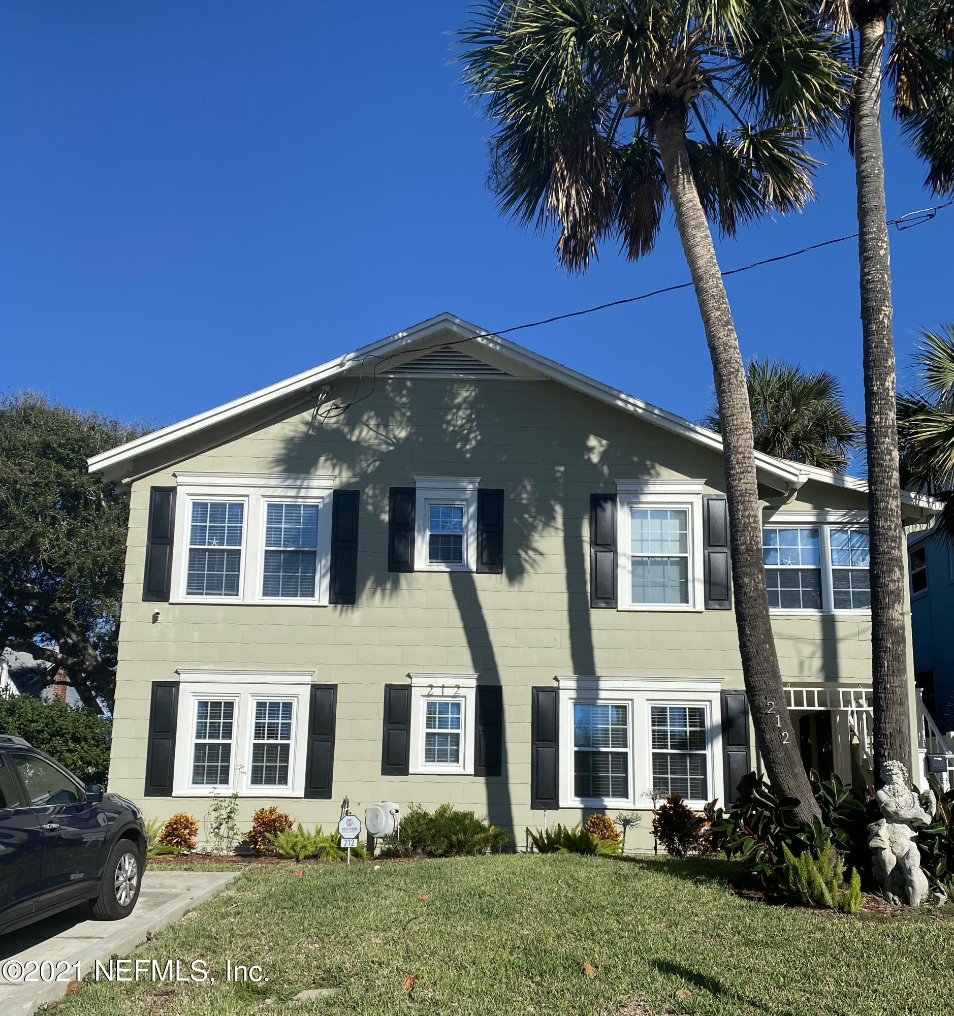 4 houses (and a church) from the Ocean!  Updated duplex with 3 car detached garage sitting on a large lot.  Hardwood floors in upper unit, new laminate floors in lower unit.  This duplex has 2/1 upstairs and downstairs.