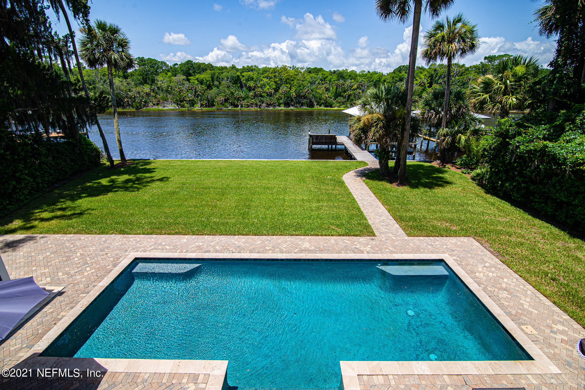 Direct ICW on 100 foot lot with dock, pool, summer kitchen...6 bedroom, 6.5 bath with 3 car garage with 1 bedroom apartment.  Major addition and remodel completed in 2014...marble countertops Thermador appliances including 6 burner stove, double oven, butlers pantry...wonderful views of the water from wall of windows across back of home both upstairs and downstairs includes full house balcony and sundeck area overlooking pool and large private backyard. Large bedrooms with walk in closets and 3rd flr bedroom / playroom w/full bath and closets. Owner suite has 2 walk in custom closets and gas fireplace with double French doors to balcony. Other features: dock with 8000lb covered boat lift, 3 fireplaces, 2 staircases, formal living and dining room. Perfect waterfront home Florida living!