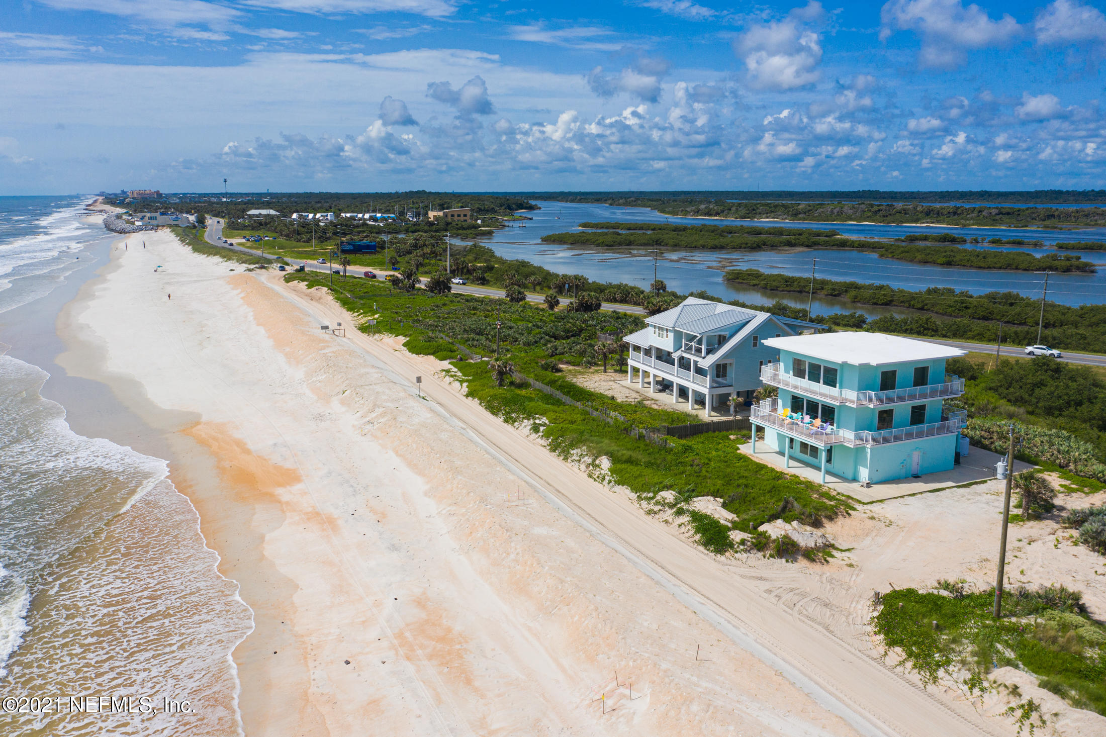 Straight out of Luxury Living magazine is this one-of-a-kind property offering over 1/2 acre of pristine and undisturbed ocean, Intracoastal, and marsh views.  Located on 120 feet of direct oceanfront, this 3bd/3.5 bath custom home with top-of-the-line finishes, has wrap around porches on the 2nd and 3rd floors to take advantage of all the Old Florida lifestyle has to offer.  Built in 2003, this steel and concrete structure has a piling system 60 feet deep, there are brand new hurricane impact windows throughout, and a new Rhino Shield flat roof as well as Rhino Shield exterior paint. The interior is thoughtfully planned with the entire master bedroom suite on the 3rd floor, living room, sitting room, dining room, kitchen and laundry on the 2nd floor and 2 guest bedrooms and bathrooms along with secondary living room/game room with kitchenette on the 1st floor.   If you crave something different with once in a lifetime views, then this is the property for you!