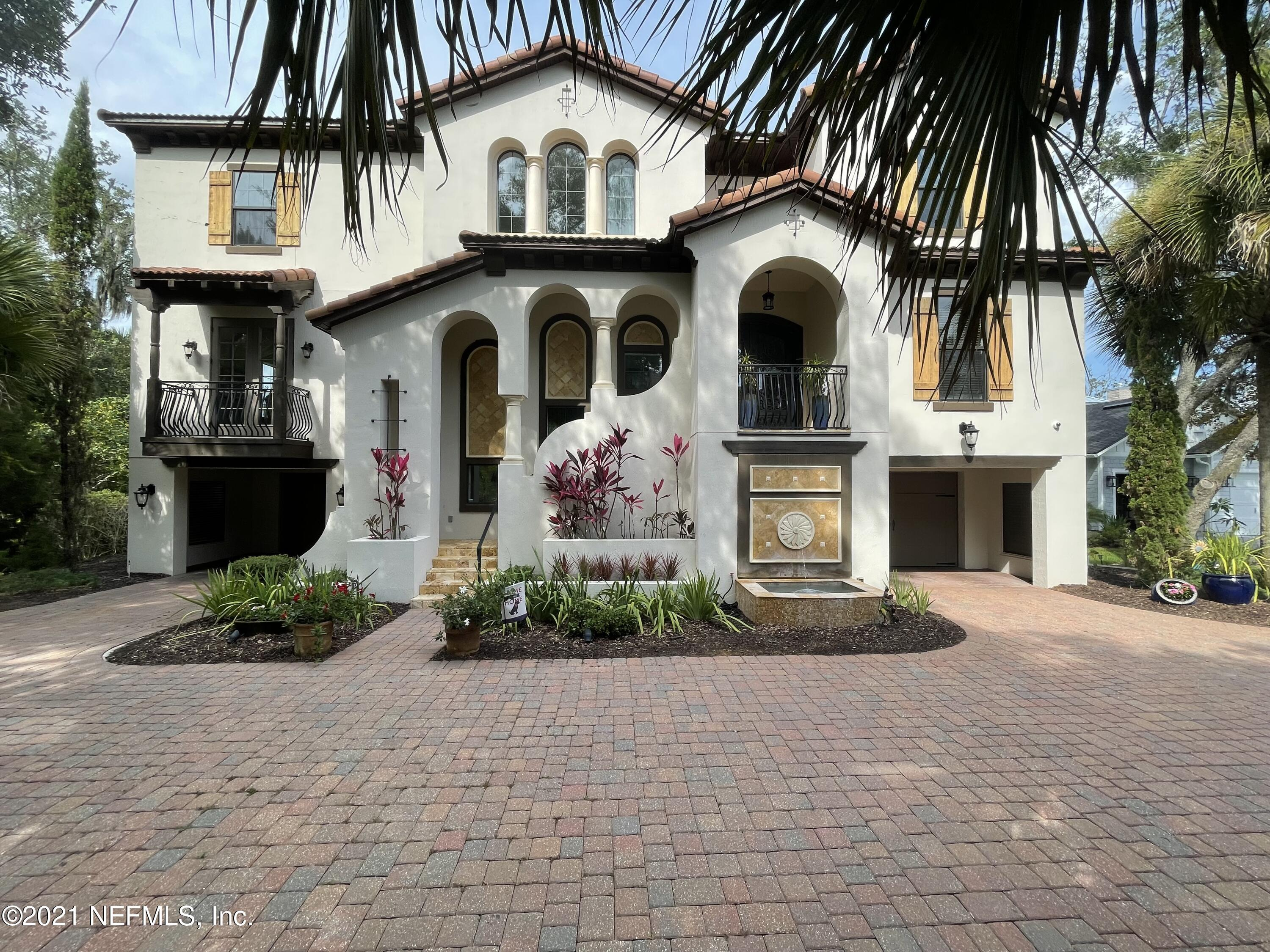 Custom 2007 Arthur Rutenberg home  w/ 100' on ICW.  NEW PICTURES COMING SOON! Stunning home, 3 levels with elevator, high-end finishes.  Hickory floors, Granite/Marble Counters, 1st level is 10-car Garage w/wine cellar/storage.  2nd level offers  Lanai w/Fireplace & Summer Kitchen, resort style Salt Water Pool & Spa, Great Rm, Kitchen, two Guest Suites, Movie Rm, & Game Room w/Wet Bar.  3rd level Owner's Suite with Coffee Bar, huge closet with washer/dryer hookup, Balcony w/Fireplace, Workout Room/Office, plus two more Bedrooms w/en-suite Baths.Fabulous Chefs Kitchen has it all: Lg. Monogram Refrigerator & Freezer, 6-burner gas GE Monogram range w/double ovens, built in GE Monogram Wall Oven and Advantium Microwave/Oven, separate Meile built-in Coffee Maker, Kitchen Aide Dishwasher