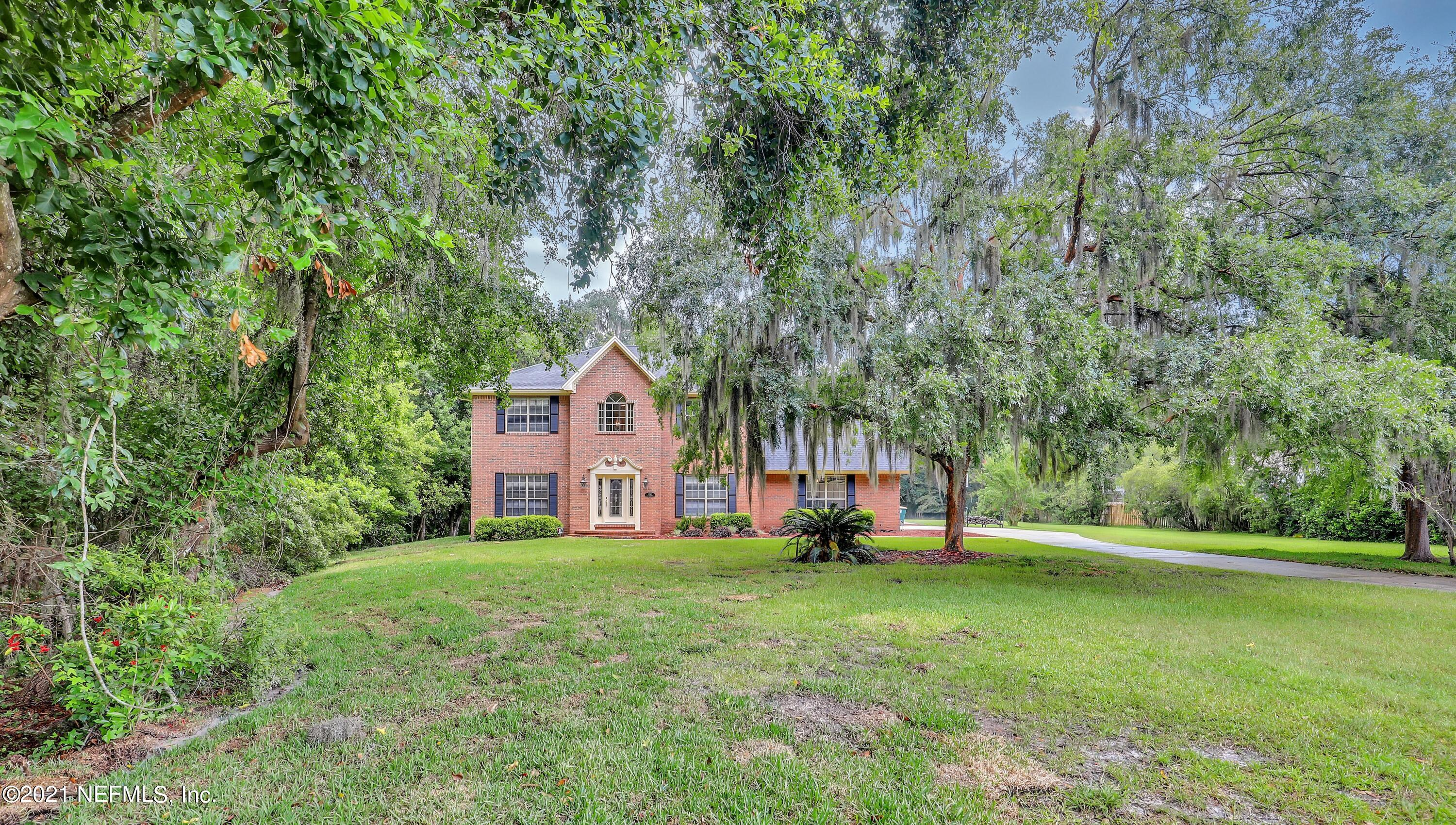 Beautiful custom two story brick home on 2.5 acres bordering Clearwater Creek and wetlands. The home sits by itself on a private cul-de-sac on a large, wooded/private lot. 5 bedrooms, 3 1/2 baths, large open kitchen with custom cherry cabinets and upgrades, all bathrooms have been renovated and upgraded to include glass showers, marble vanity tops and stone flooring. White oak flooring downstairs in kitchen, foyer, hall and dining, luxurious high grade carpeting throughout the house. Fireplace with floor to ceiling cabinetry on both sides with mantle. Built in bookcase upstairs overlooks foyer below. 10-12 ft ceilings downstairs, crown molding throughout the house. Large swimming pool and spa with expansive multi-level decking, enclosed by classic aluminum fencing.